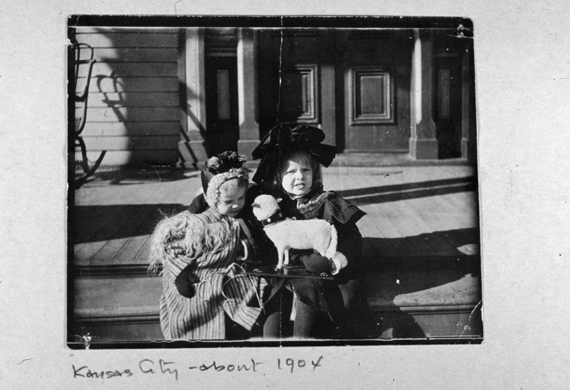 Baby picture of pilot Amelia Earhart with a dog, a toy sled, and her cousin Otis Balis, Kansas City.