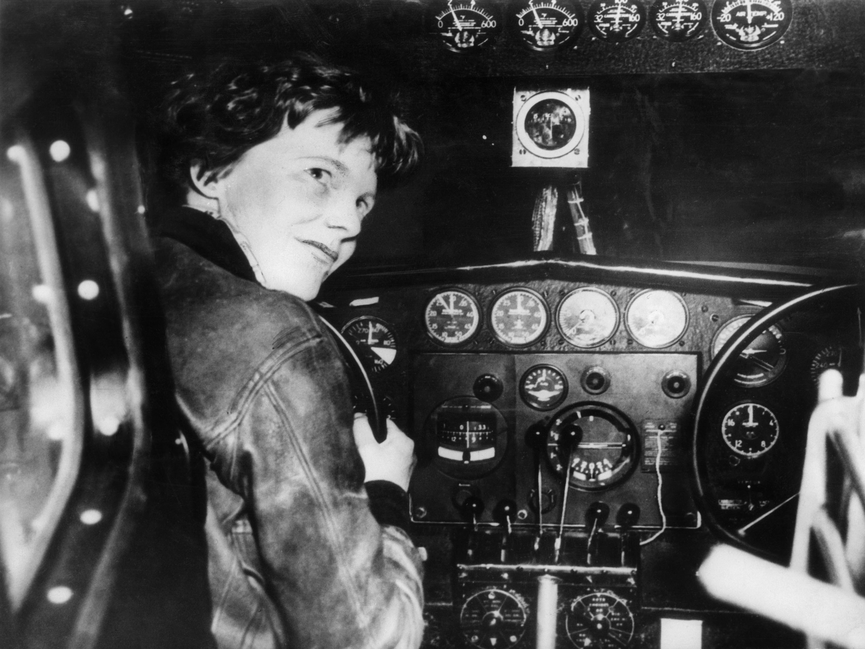 Undated picture taken in the 1930s of American aviator Amelia Earhart, at the controls of her plane.