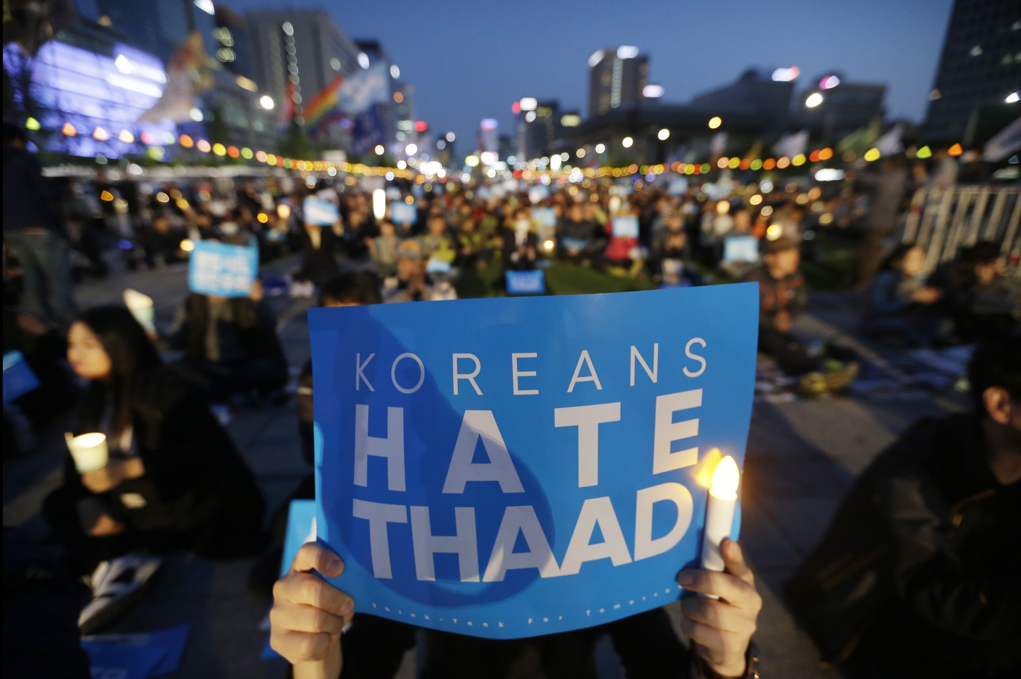 South Korean protesters stage a rally to oppose a plan to deploy the advanced U.S. missile defense system called Terminal High-Altitude Area Defense, or THAAD, near U.S. Embassy in Seoul, South Korea, Saturday, April 29, 2017.