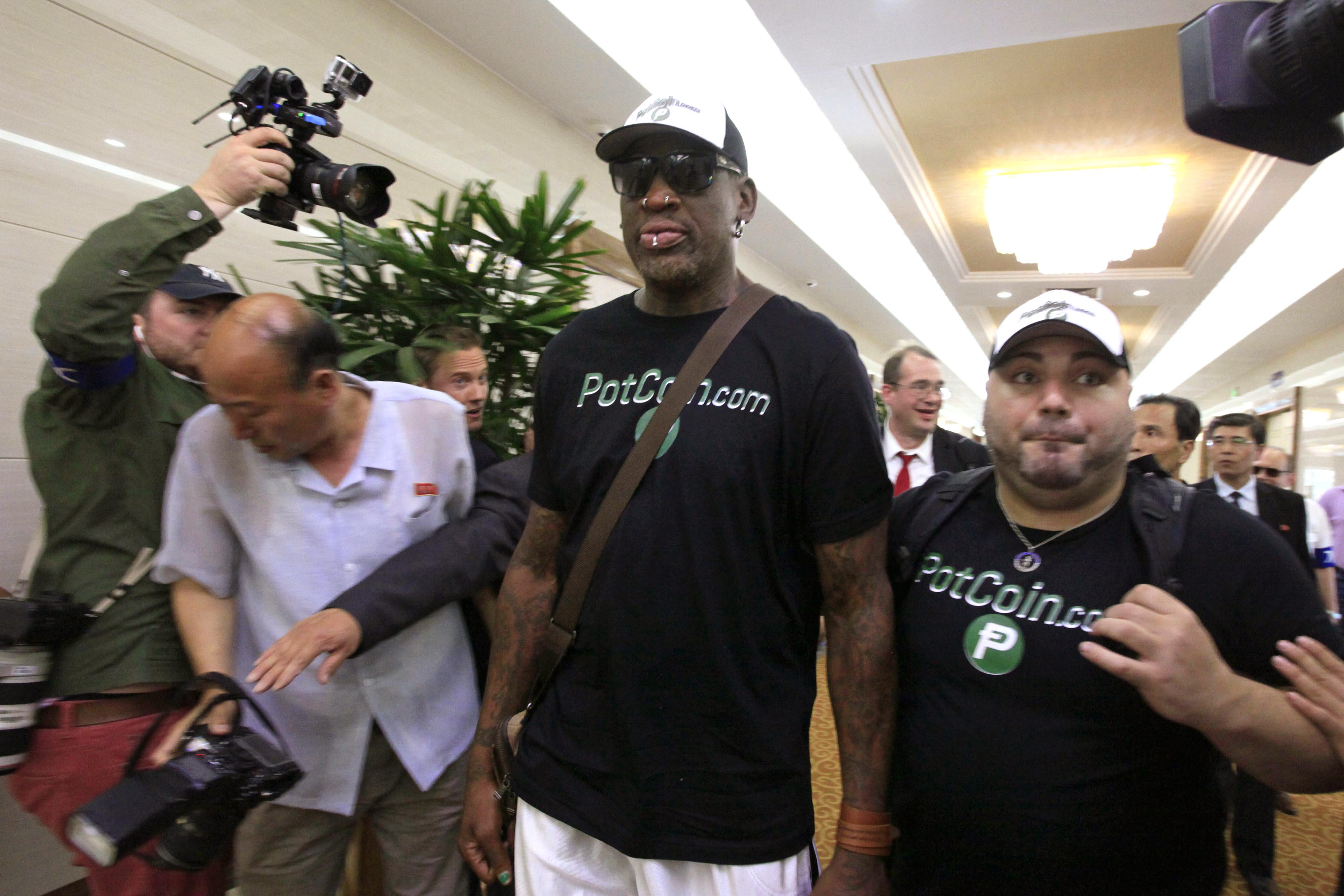 Former NBA basketball star Dennis Rodman, center,  arrives at Sunan International Airport on Tuesday, June 13, 2017, in Pyongyang, North Korea.