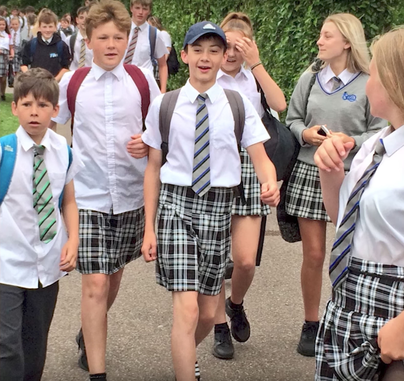 Male students at the Isca Academy in Exeter, England, wear skirts in protest of the school's shorts ban on June 22, 2017.