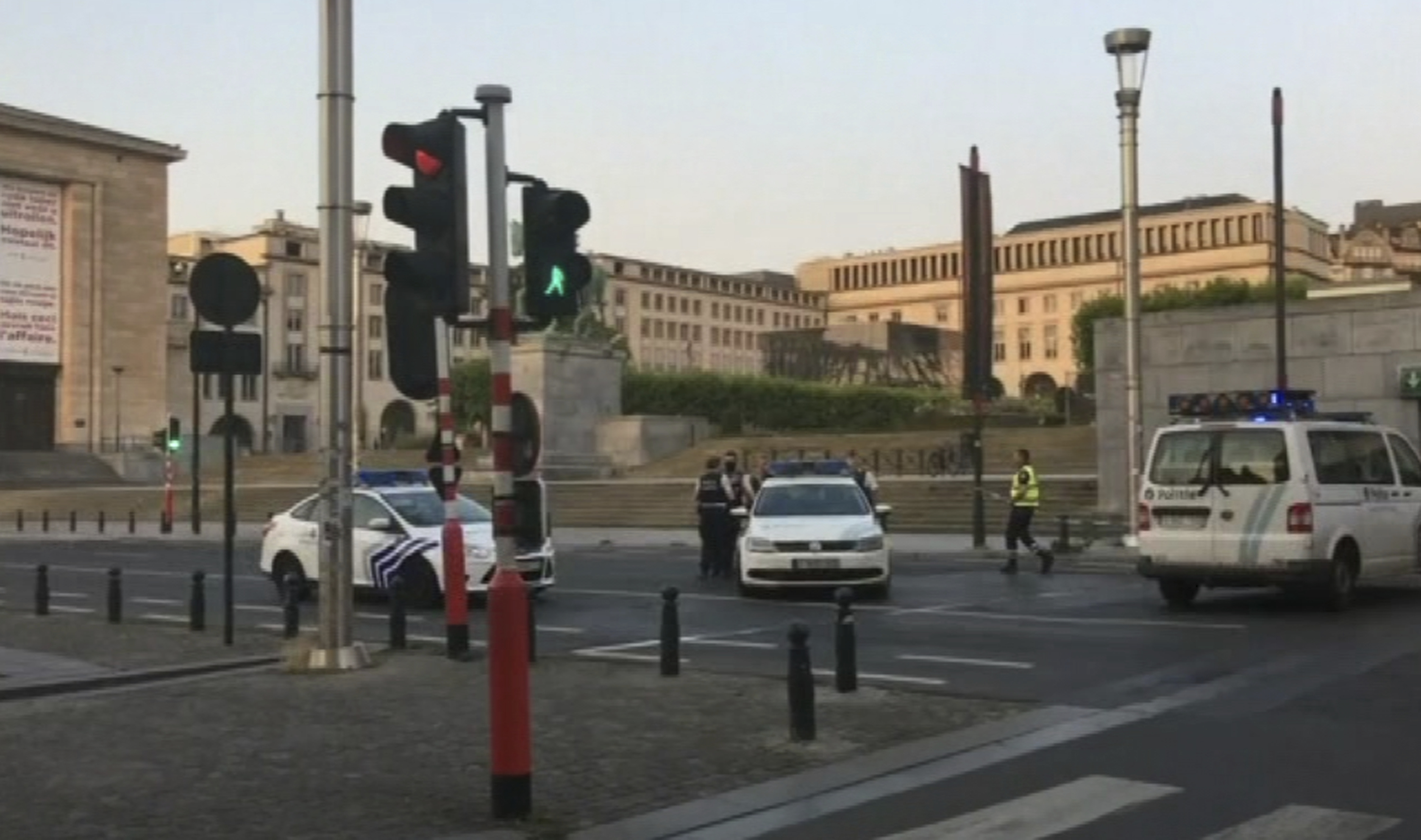 In this image taken from video, police cars create a cordon near the train station in central Brussels on June 20, 2017. Belgian media report that explosion-like noises have been heard at a Brussels train station; the main square evacuated.