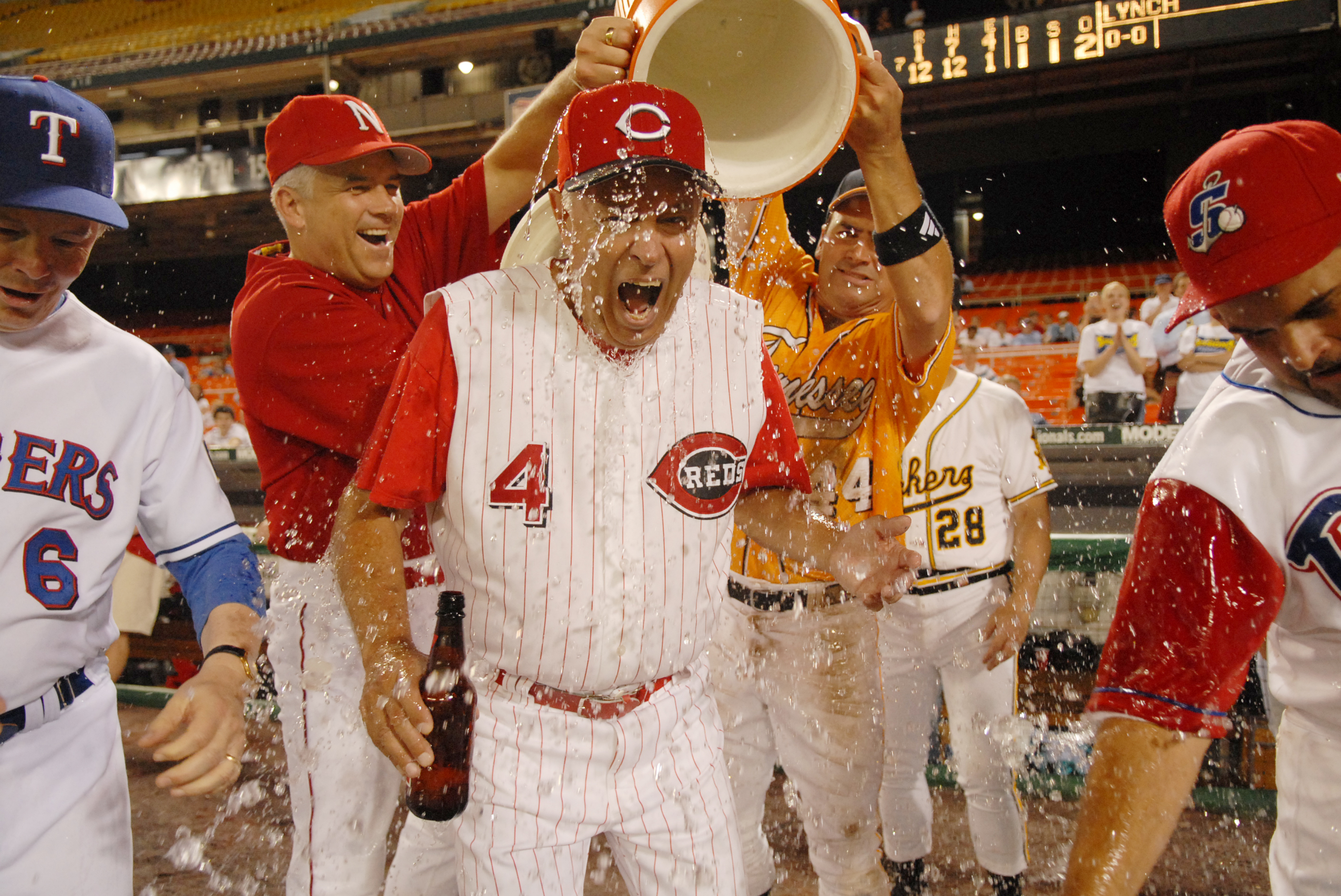 Coach Mike Oxley, R-Ohio, gets water dumped on him in celebration at the 45th Annual Roll Call Congressional Baseball game played at RFK stadium.
