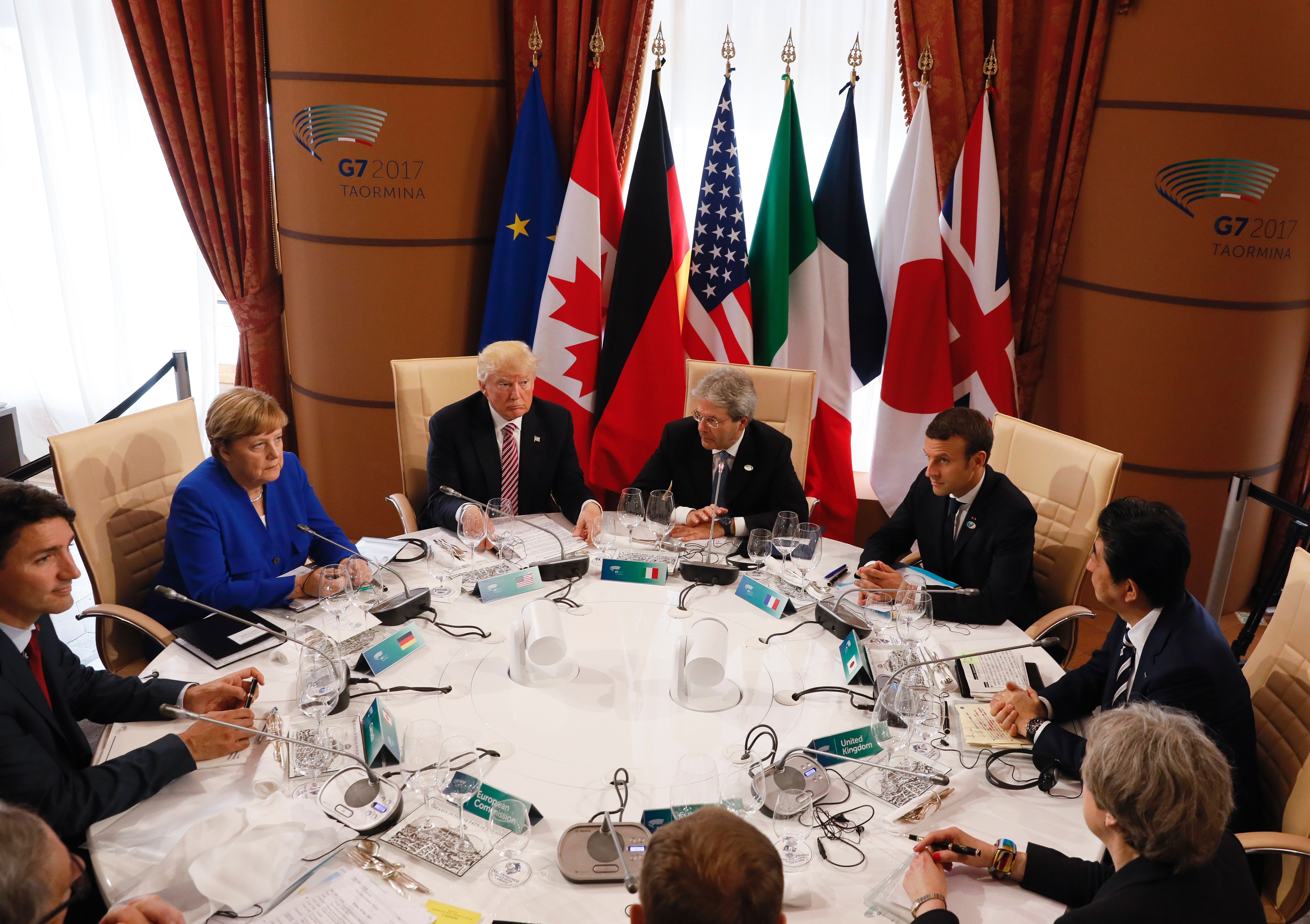 From left: Canadian Prime Minister Justin Trudeau, German Chancellor Angela Merkel, U.S. President Donald Trump, Italian Prime Minister Paolo Gentiloni, French President Emmanuel Macron, Japanese Prime Minister Shinzo Abe, Britains Prime Minister Theresa May, European Council President Donald Tusk and European Commission President Jean-Claude Juncker sit around a table during the G7 Summit of the Heads of State and of Government in Taormina, Sicily, on May 26, 2017.