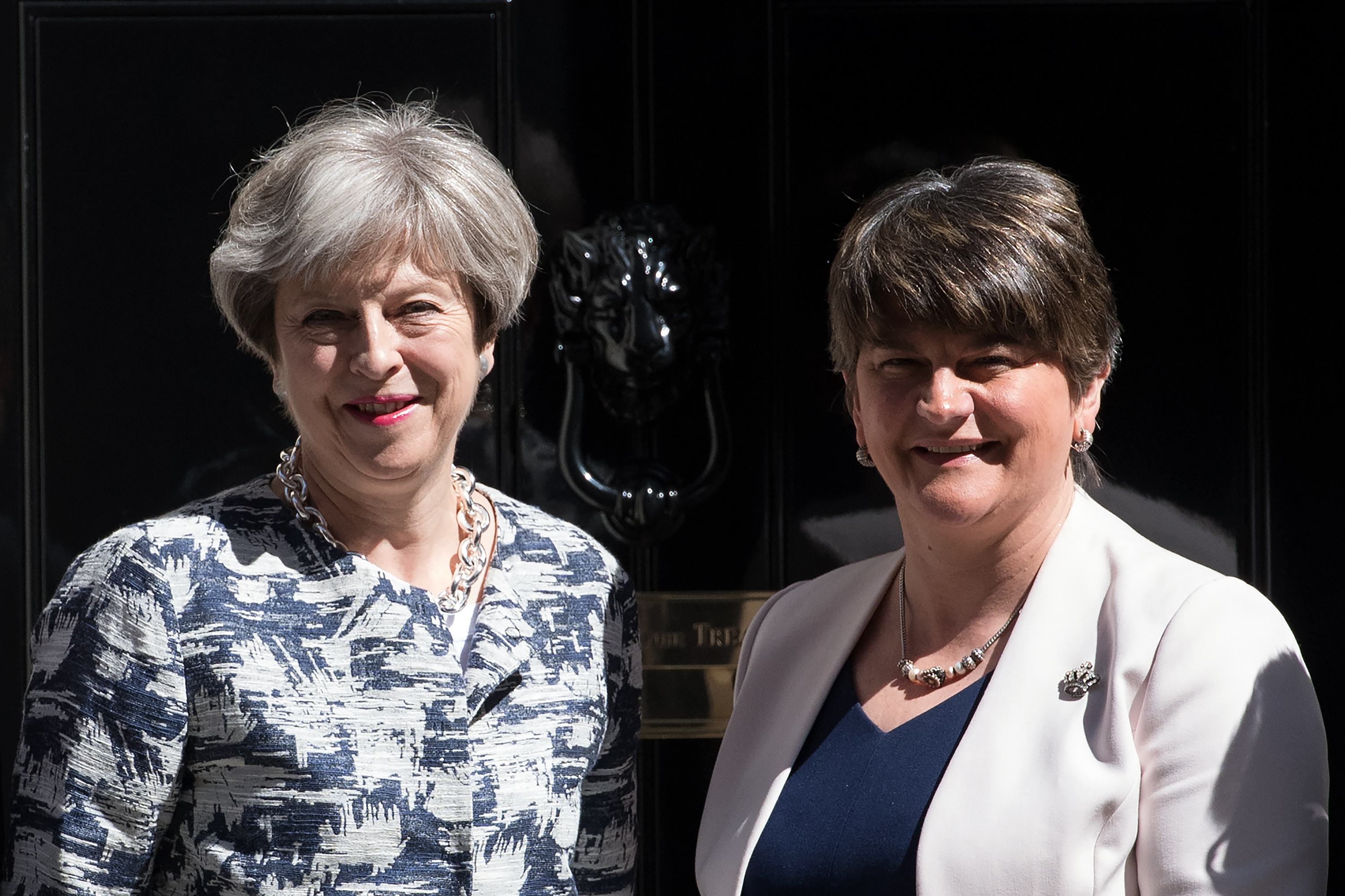 Britain's Prime Minister, Theresa May (L), greets Arlene Foster, the leader of Northern Ireland's Democratic Unionist Party in Downing Street on June 26, 2017 in London, England.