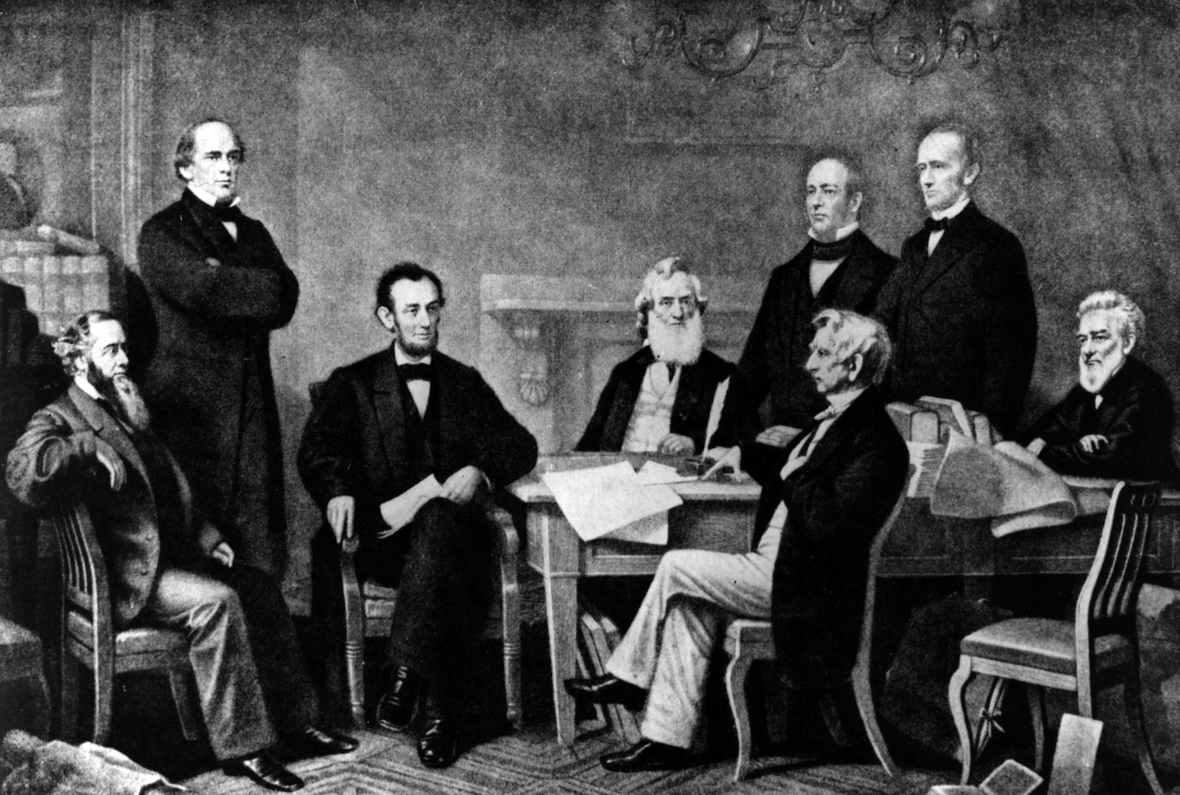 Abraham Lincoln at the signing of the Emancipation Proclamation, which gave slaves their freedom.