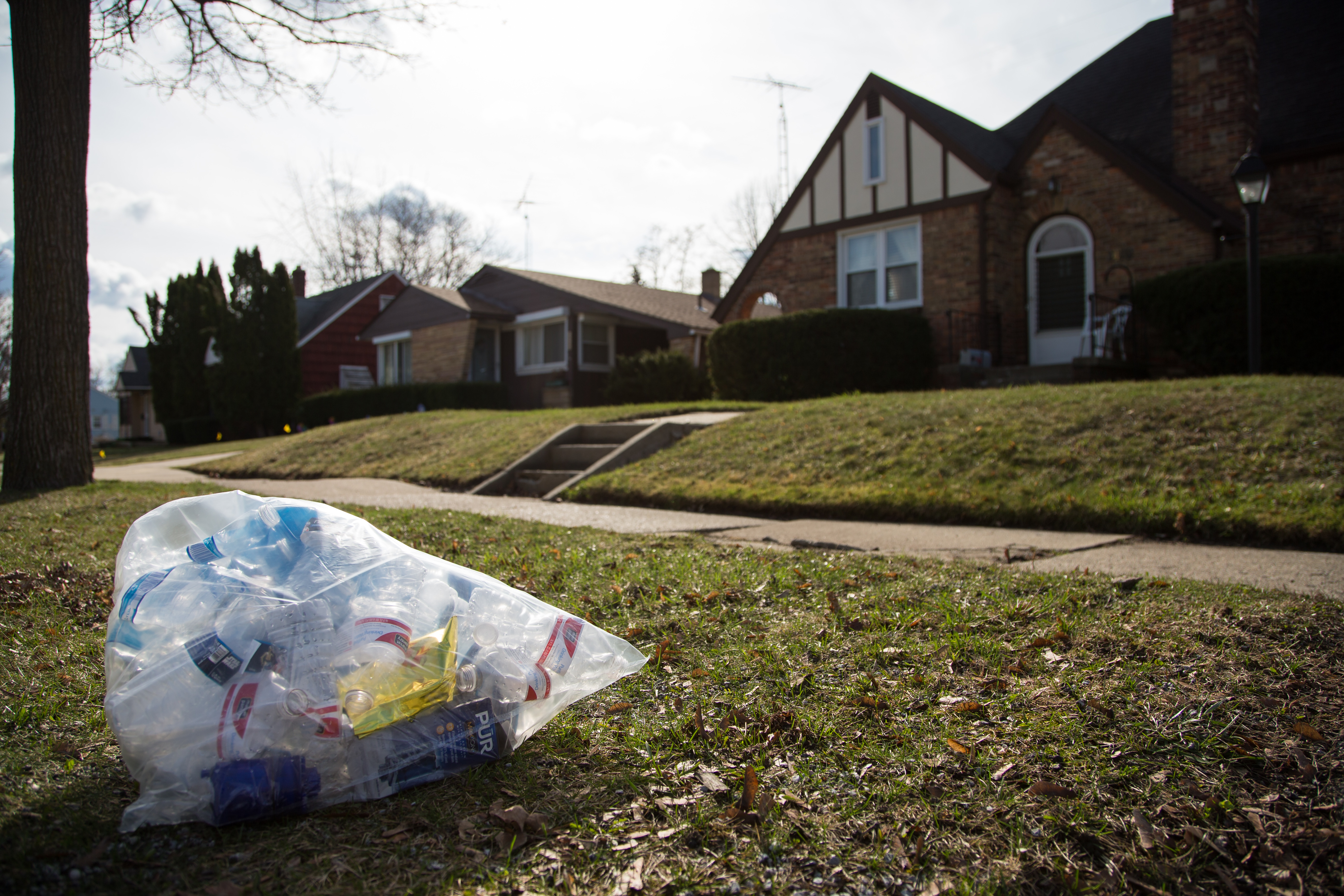 A trash bag filled with empty water bottles and water filters outside of a house on March 17, 2016 in Flint, Michigan.