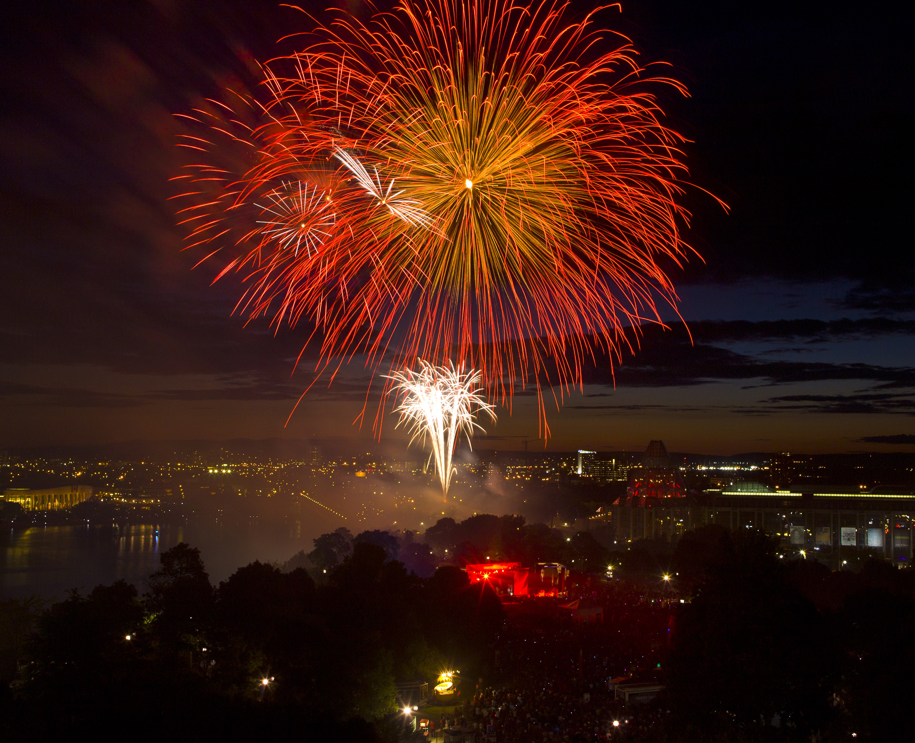 A fireworks display over the Alexandra Bridge and National Gallery as viewed from Parliament Hill as thousands gather to celebrate Canada Day on July 1, 2012, in Ottawa, Canada.