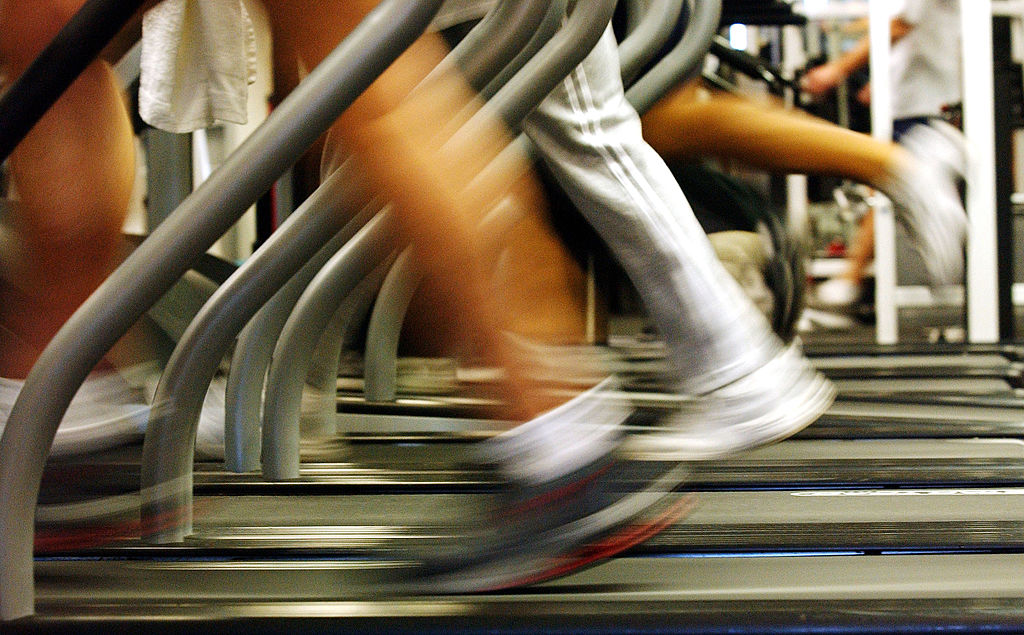 BROOKLYN, NEW YORK - JANUARY 2:  People run on treadmills at a New York Sports Club January 2, 2003 in Brooklyn, New York. Thousands of people around the country join health clubs in the first week of the new year as part of their New Year's resolution. Many health clubs see a surge in business of 25 percent immediately after the new year, only to see those numbers level off by spring.  (Photo by Spencer Platt/Getty Images)