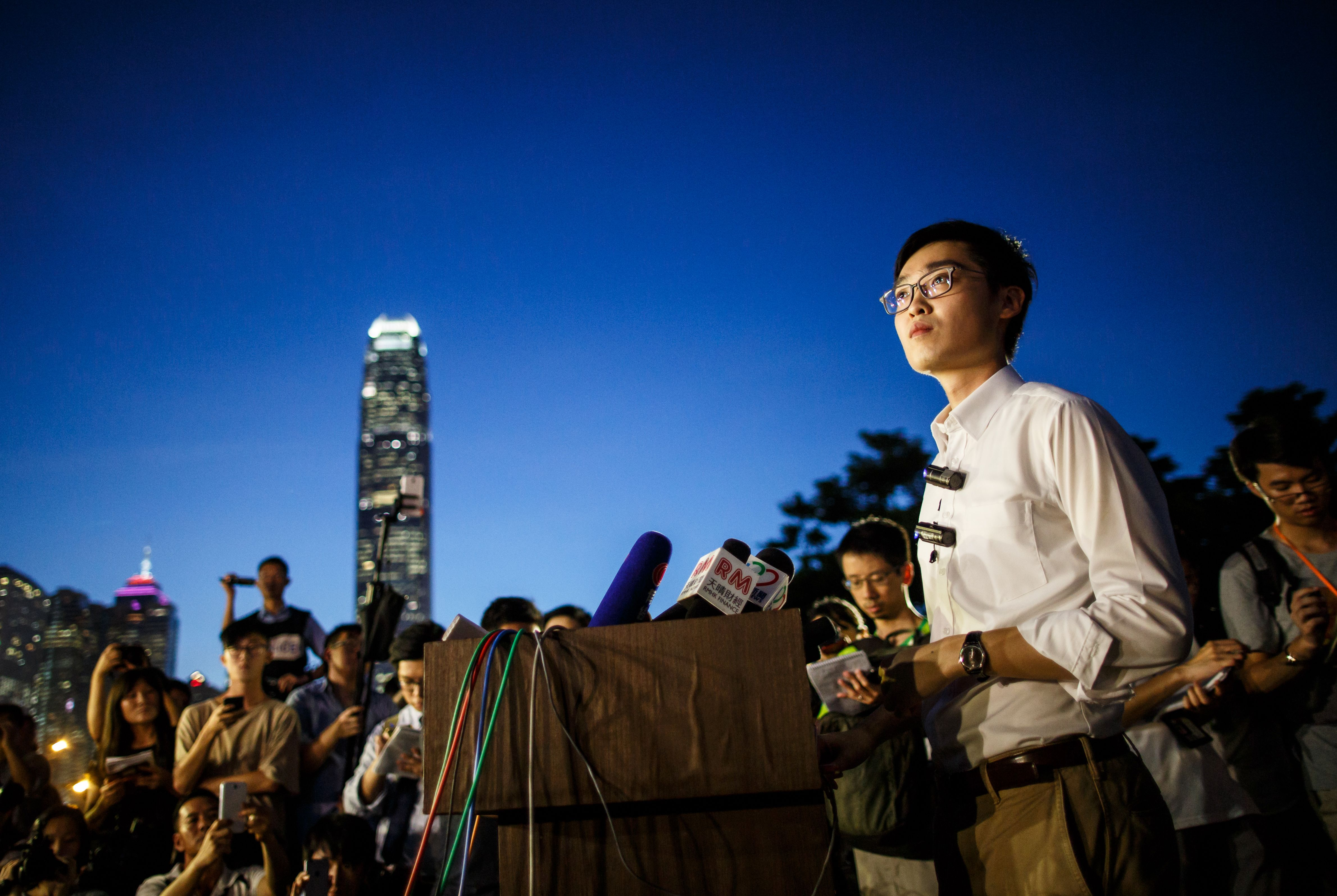 Andy Chan (R), 25, leader of the pro-independence Hong Kong National Party and a disqualified candidate of upcoming elections, gives a press conference at the start of a rally near the government's headquarters in Hong Kong on August 5, 2016. The gathering was the first pro-independence rally in Hong Kong history and likely the first time that a community of Han Chinese — as opposed to Uighurs or Tibetans — had demanded independence from the People's Republic.