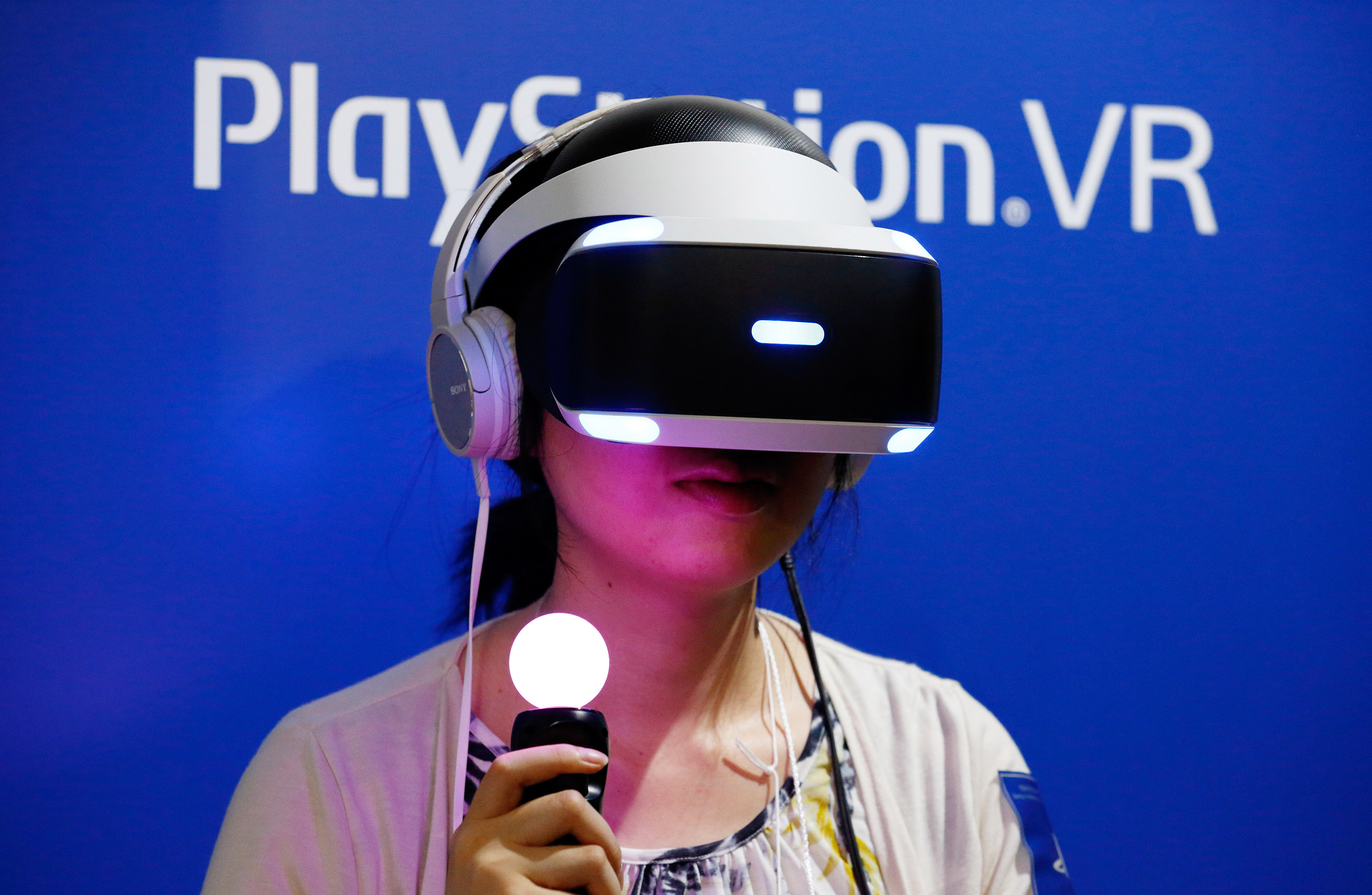 A visitor wearing a Sony Interactive Entertainment Inc. PlayStation VR headset plays a video game at the Tokyo Game Show 2016 on September 15, 2016 in Chiba, Japan.