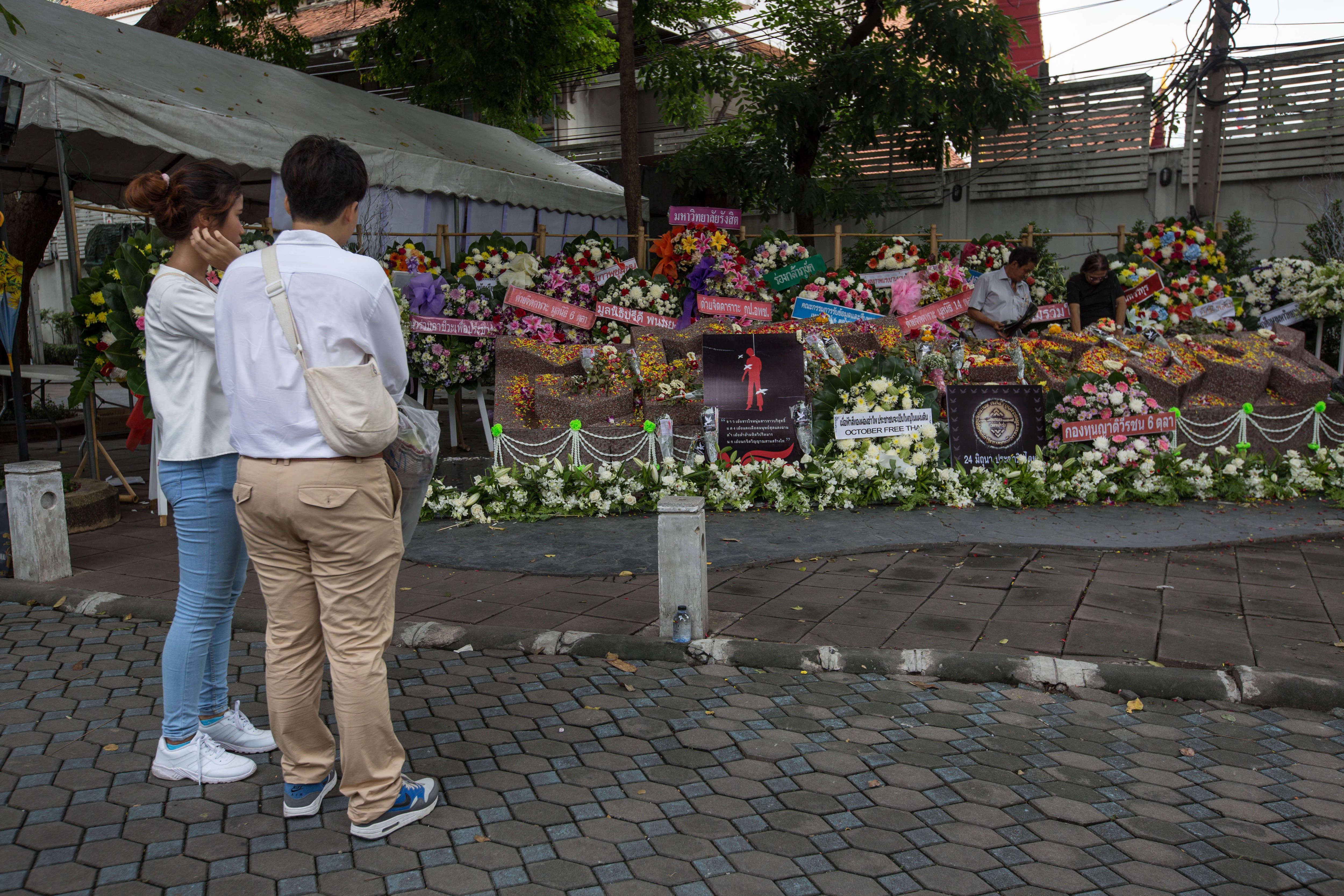 People visit the 40th anniversary memorial inside Thammasat University Campus on Oct. 6, 2016, as Thailand marks the 40th anniversary of the Thammasat University massacre.