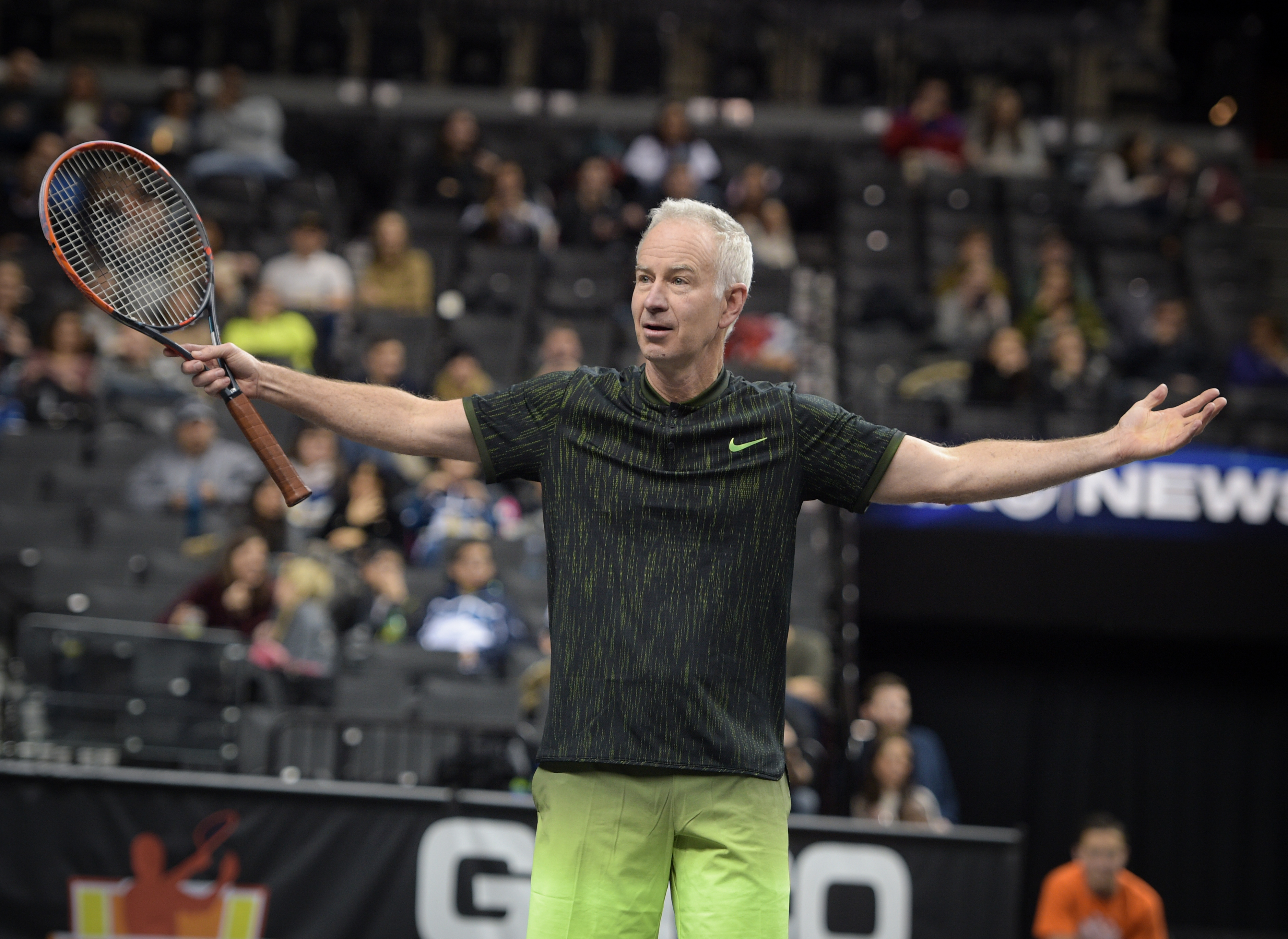 Tennis player John McEnroe plays tennis at the 2016 PowerShares QQQ Cup at Barclays Center of Brooklyn on January 7, 2017 in the Brooklyn borough of New York City.