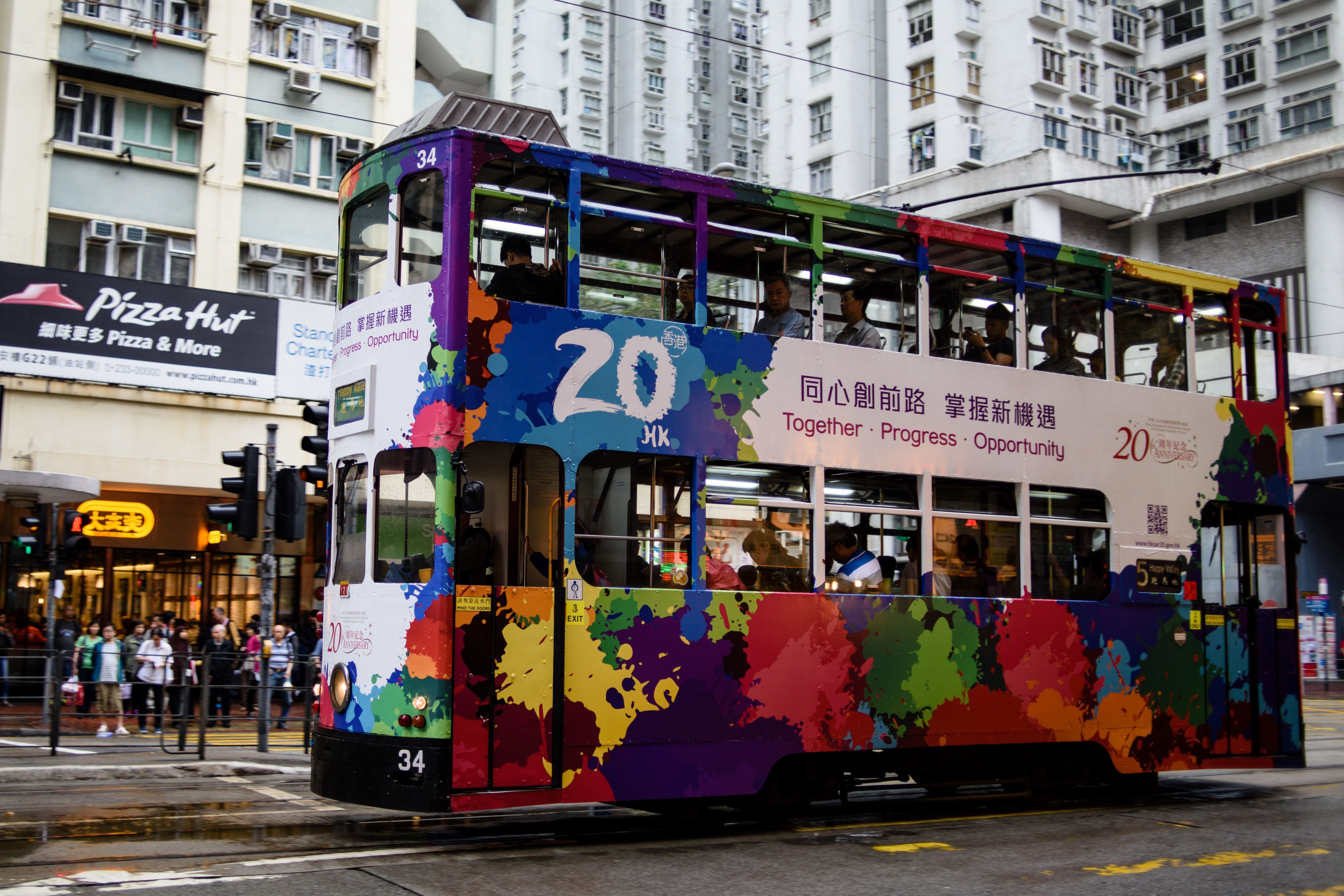 In this photo taken on April 27, 2017, commuters travel on a tram with a design commemorating the 20th anniversary since the city was handed back to China in Hong Kong.