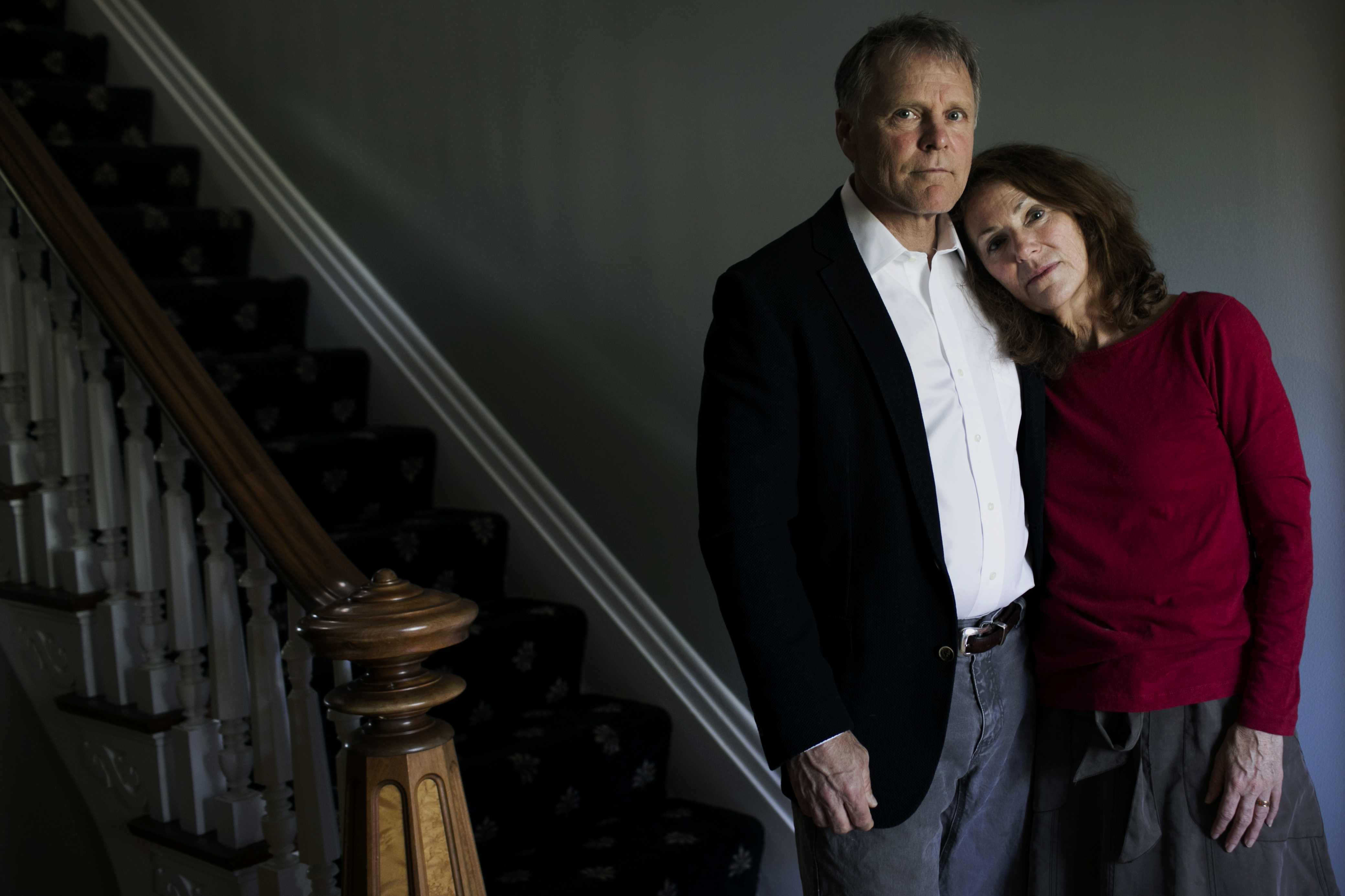 Fred and Cindy Warmbier stand in their home.