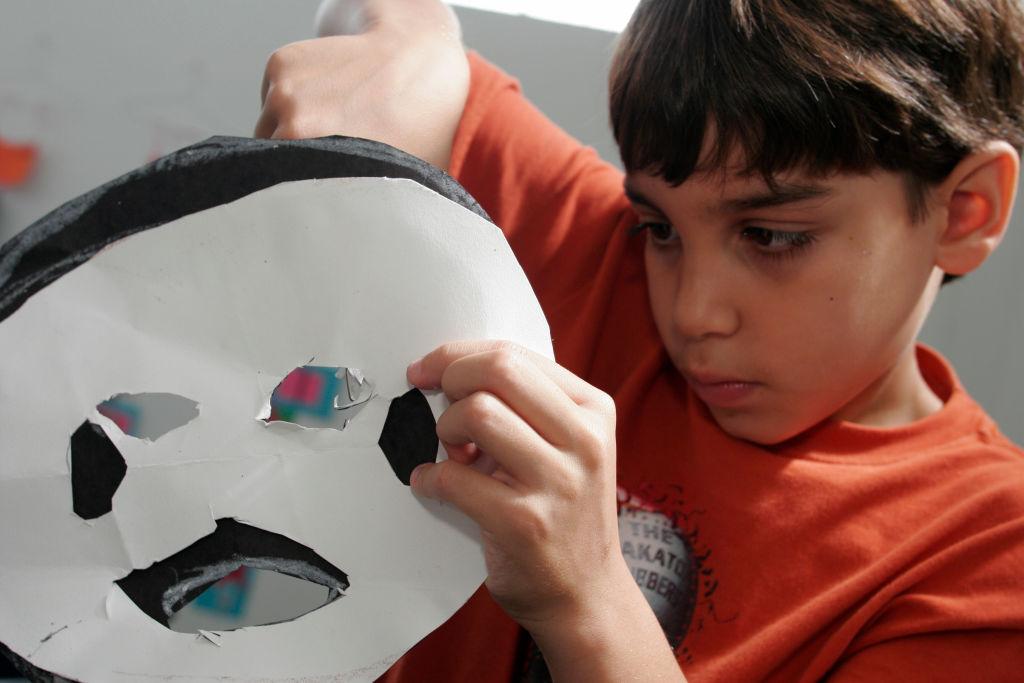Art Center South Florida, Art Camp, Boy making Paper Crafts. (Photo by: Jeffrey Greenberg/UIG via Getty Images)