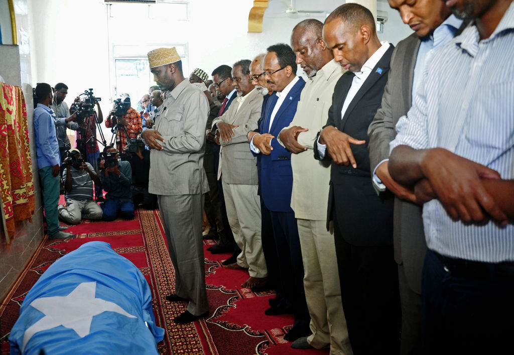 Somali officials pray over the body of Abdullahi Siraji during his funeral in Mogadishu on May 4, 2017.