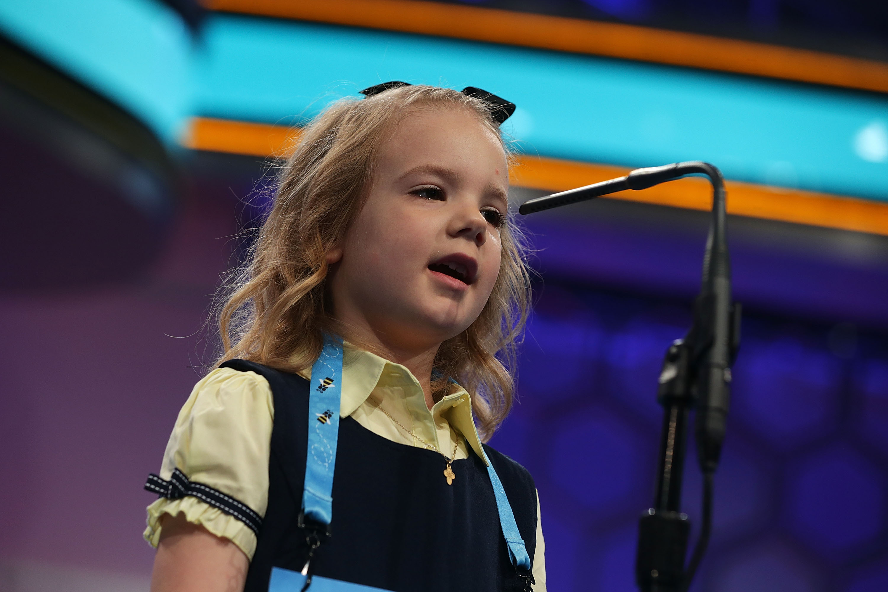 Edith Fuller of Tulsa, Oklahoma, who is the youngest speller this year, spells her word during round two of 2017 Scripps National Spelling Bee at Gaylord National Resort & Convention Center May 31, 2017 in National Harbor, Maryland.