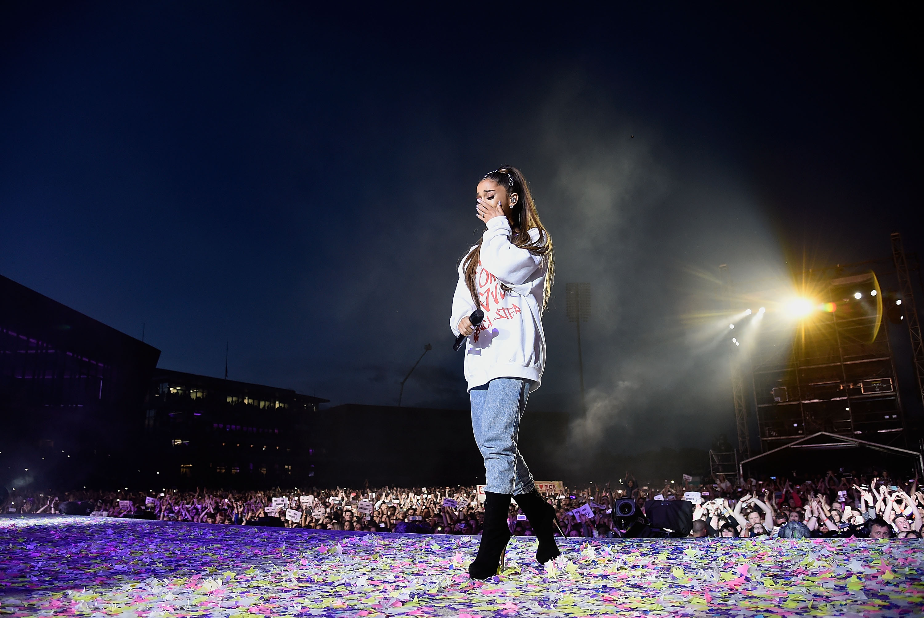 Ariana Grande wipes away a tear as she performs on stage during the One Love Manchester Benefit Concert at Old Trafford Cricket Ground on June 4, 2017 in Manchester, England.