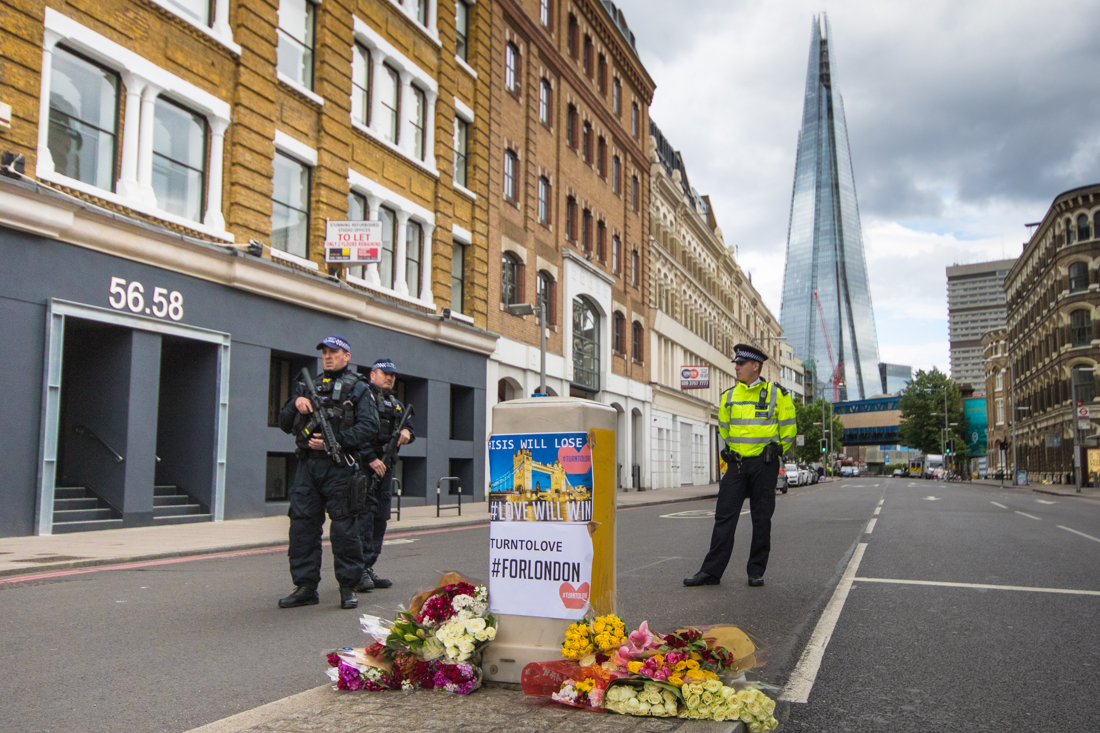 Armed police patrol the perimeter of the scene of the attack on London Bridge and Borough Market, June 4, 2017 in London.