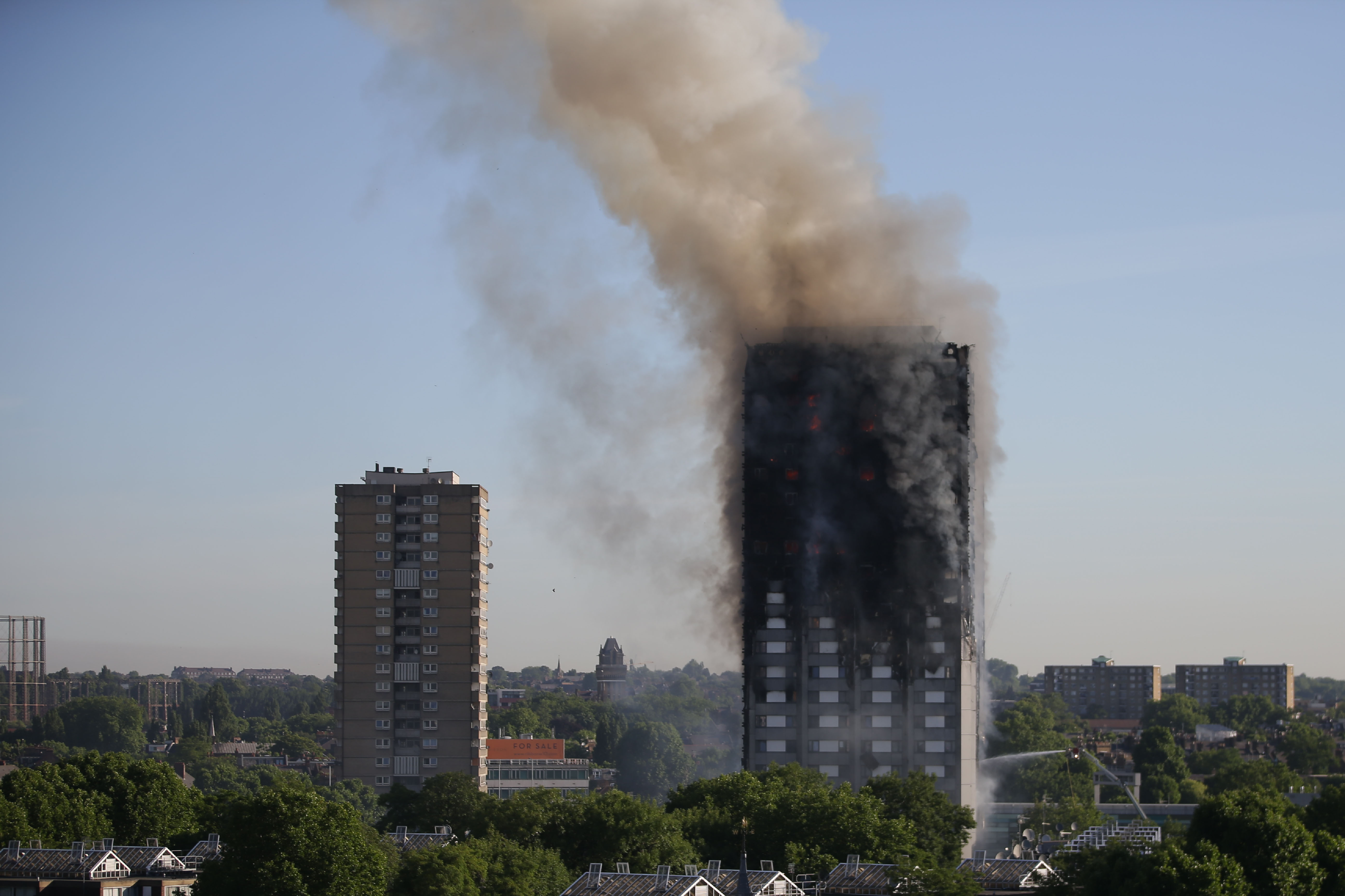 Smoke billows from Grenfell Tower as firefighters attempt to control a huge blaze  in London on June 14, 2017.