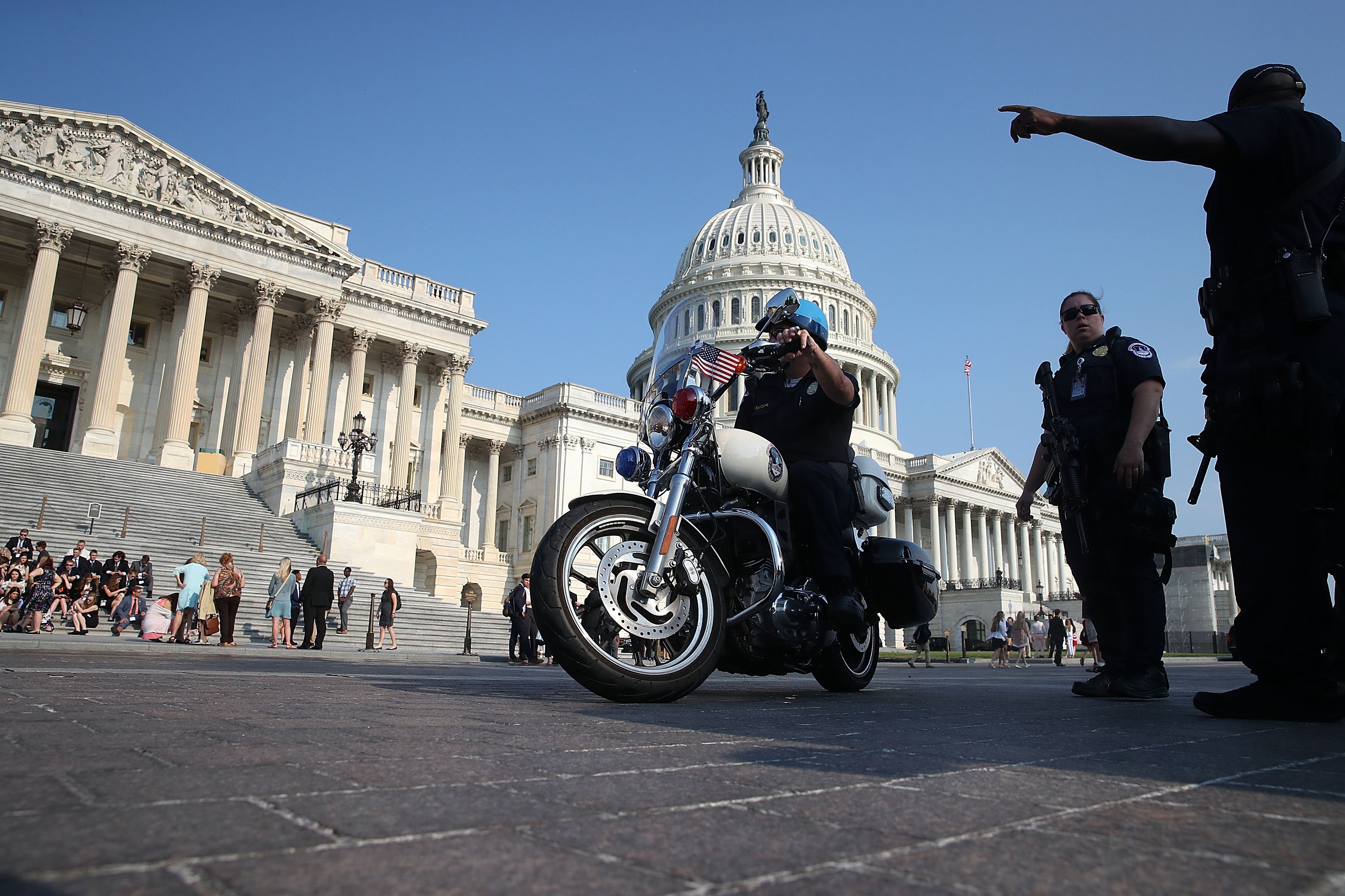 U.S. Capitol Police stand guard in front of the U.S. Capitol Building, on June 14, 2017, in Washington, DC.