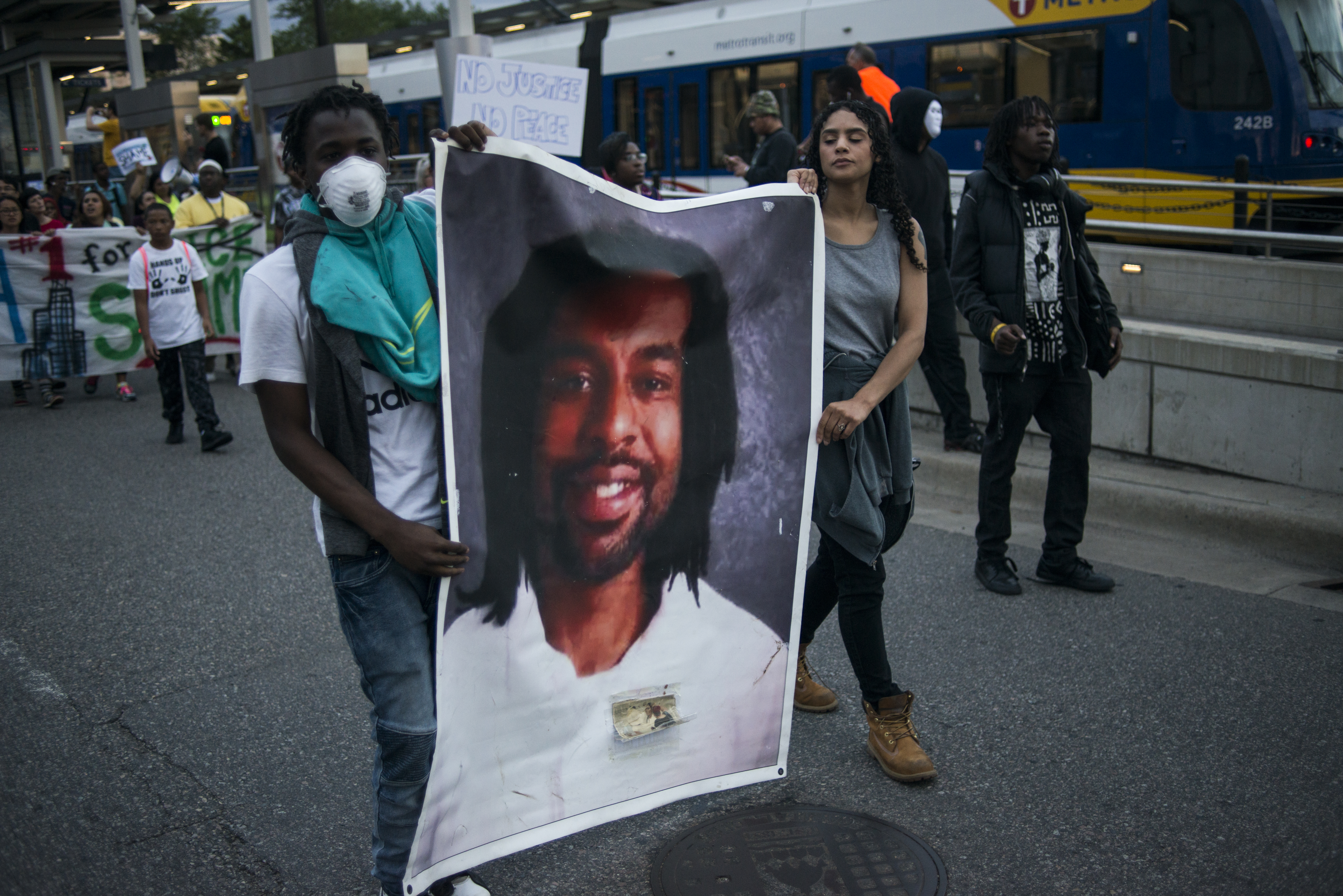Protestors carry a portrait of Philando Castile, June 16, 2017 in St Paul, Minnesota.