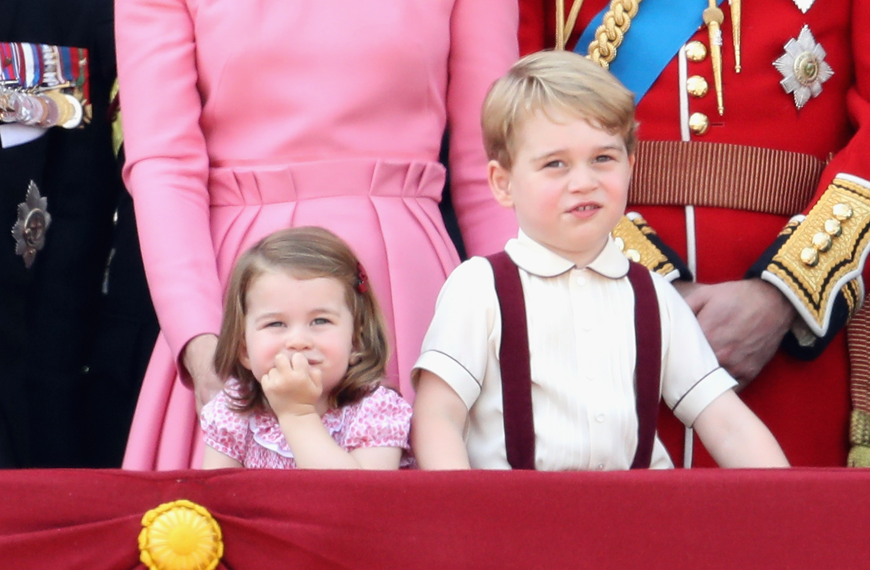 (L-R) Catherine, Duchess of Cambridge, Princess Charlotte of Cambridge, Prince George of Cambridge and Prince William, Duke of Cambridge look out from the balcony of Buckingham Palace during the Trooping the Colour parade on June 17, 2017 in London, England.
