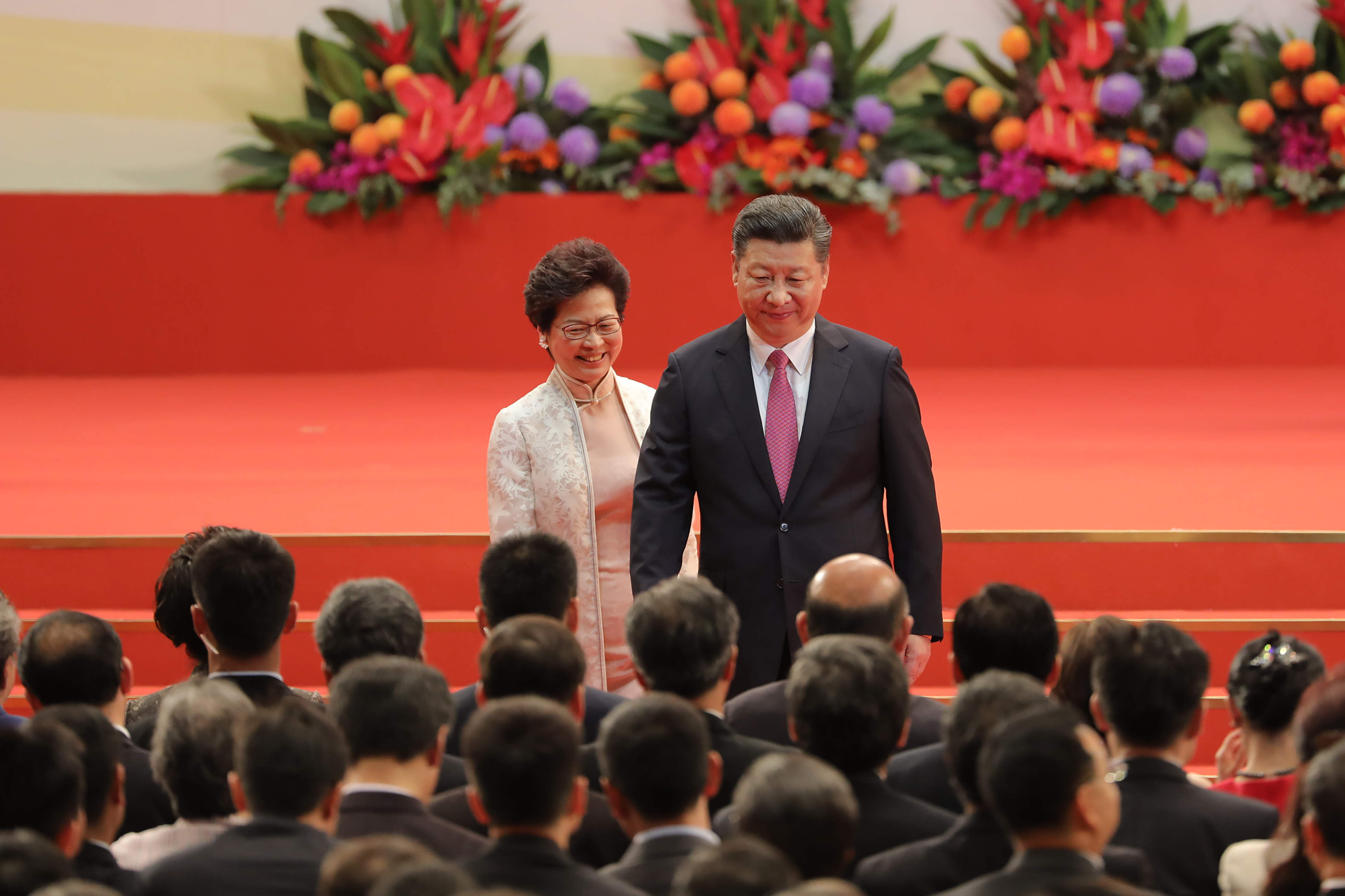 Xi Jinping, China's president, right, and Carrie Lam, Hong Kong's incoming chief executive, leave the stage during a swearing-in ceremony in Hong Kong, China, on Saturday, July 1, 2017.