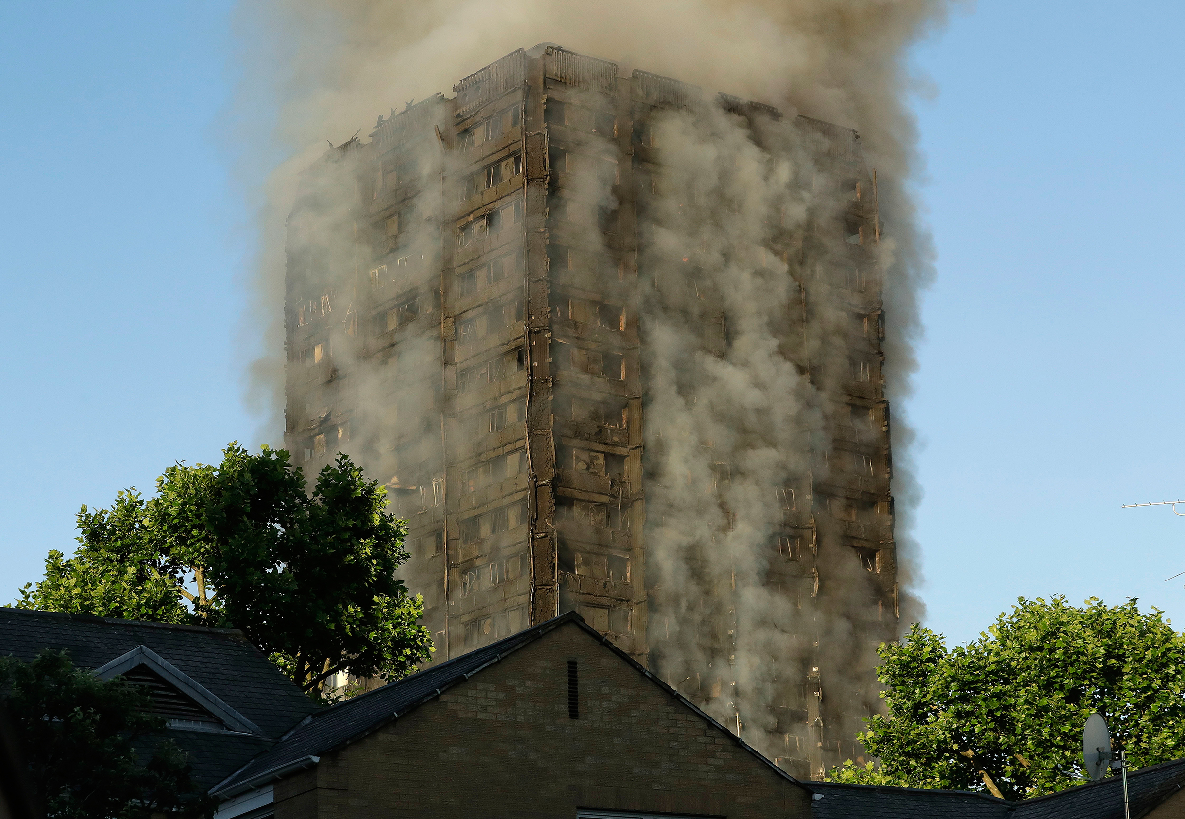 Smoke rises from a high-rise building that caught fire overnight in West London on June 14, 2017.