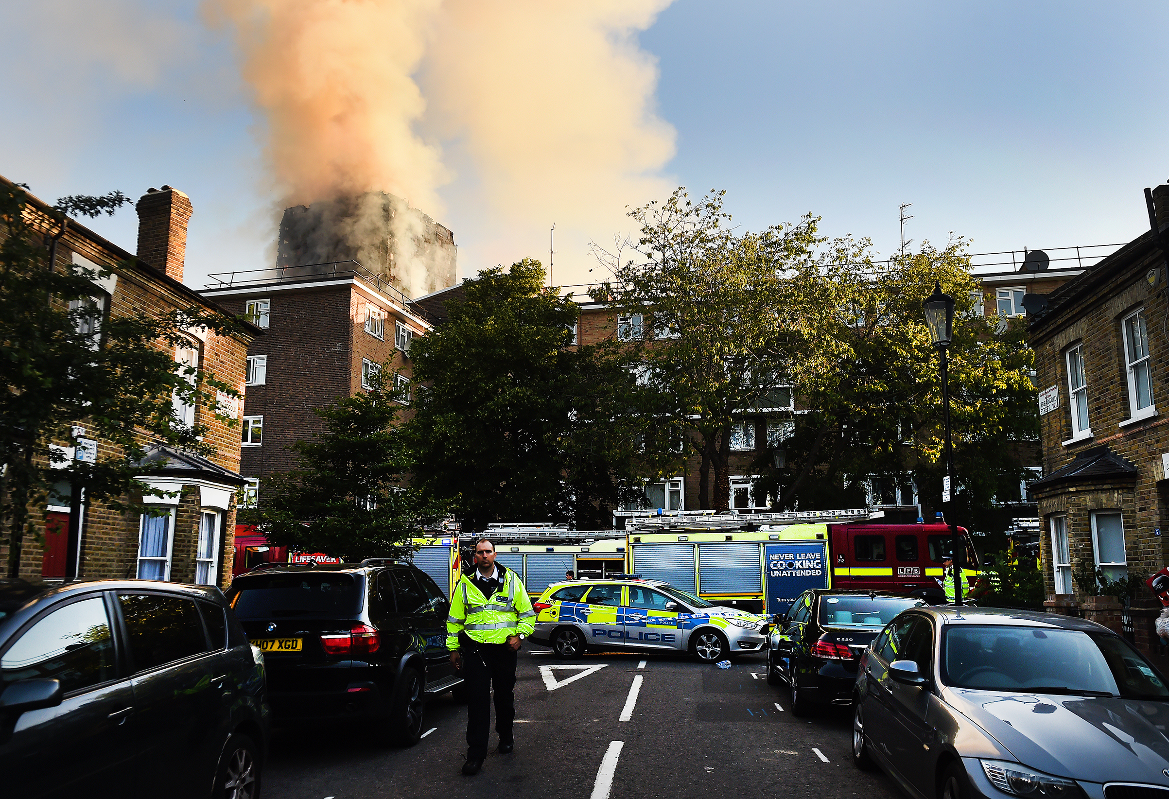 Police and rescue services operate near the fire at the Grenfell Tower apartment block in North Kensington, London, on June 14, 2017.