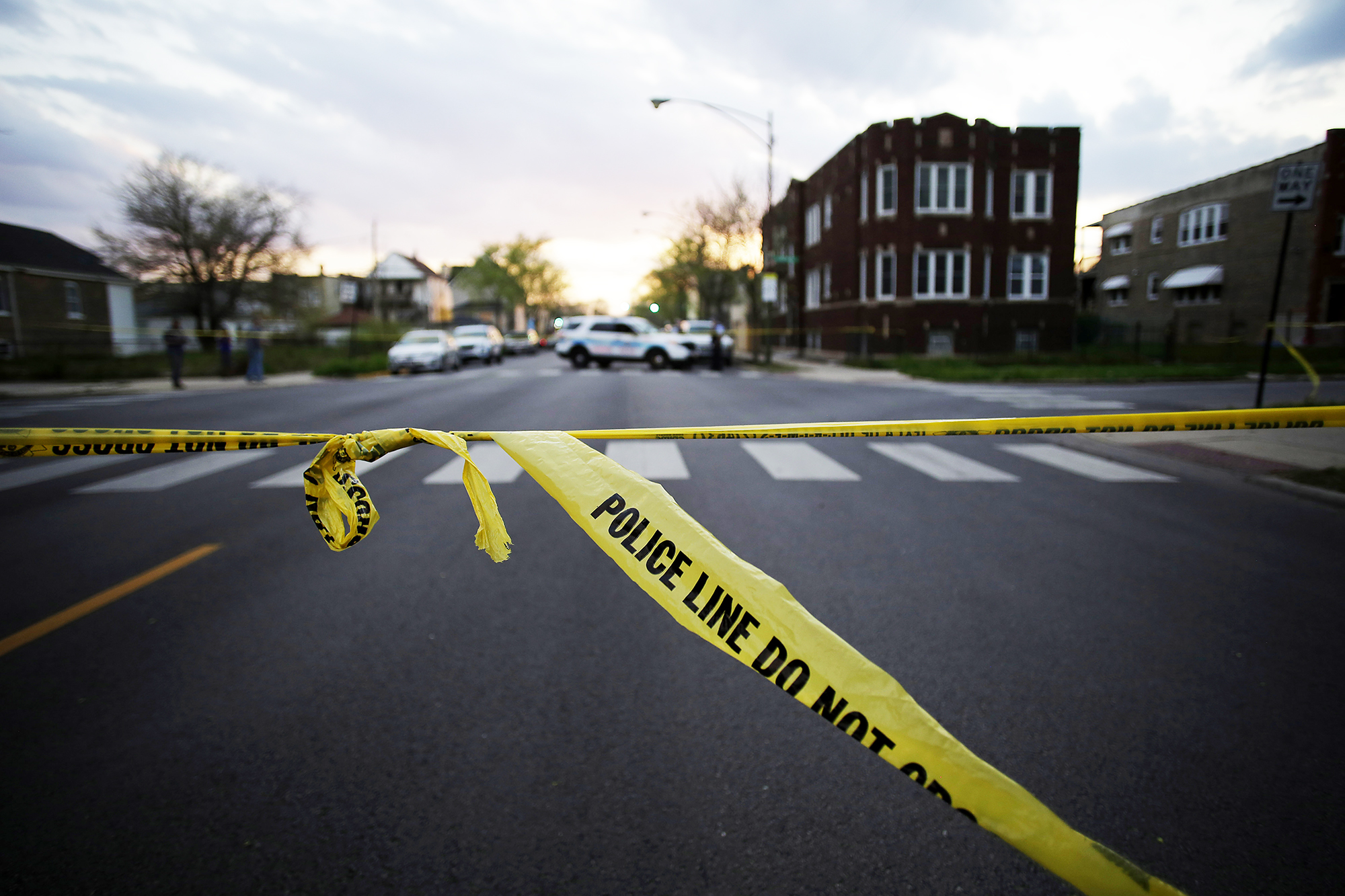 Chicago Police crime tape is displayed at the scene where a 16-year-old boy was shot in the head and killed and another 18-year-old man was shot and wounded, on April 25, 2016 in Chicago.
