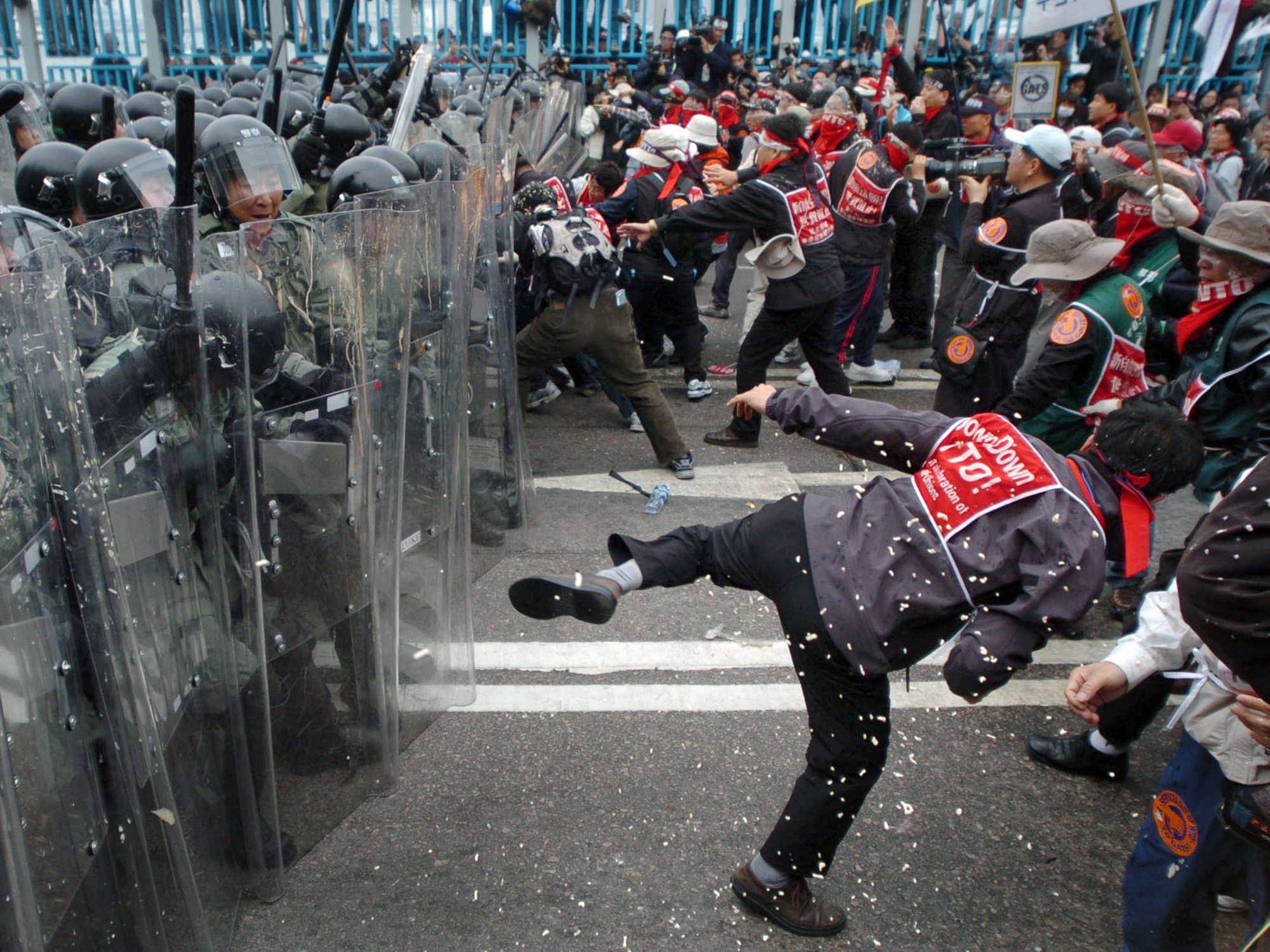 South Korean trade unionists scuffle with riot police during protests against the World Trade Organization's Sixth Ministerial Conference in Hong Kong on Dec. 14, 2005.  The vehemence of the demonstrations shocked the normally orderly territory and prefigured clashes that were to come on the same streets nine years later, when activists, this time local, would call for greater political freedom.
