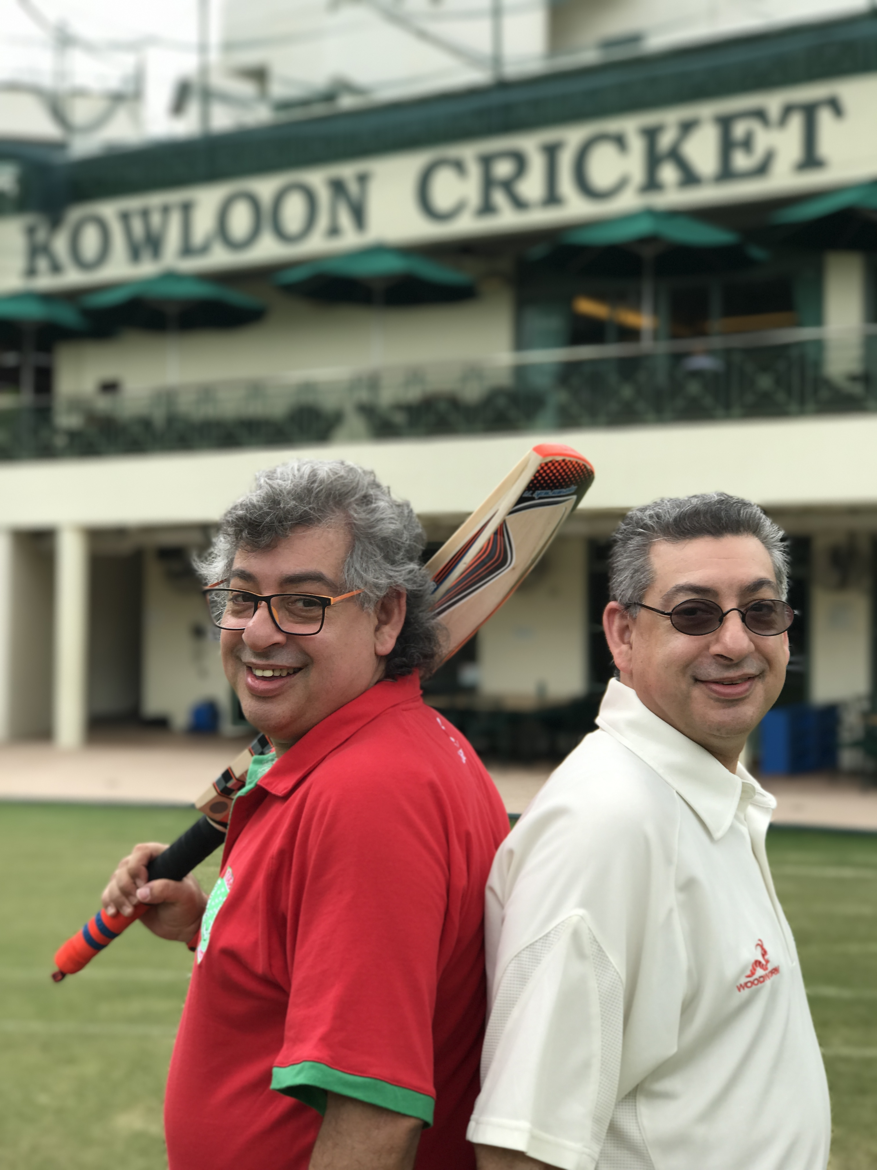 "Twin Parsi brothers Shiroy (L) and Shiraz (R) Vacha, 53, pictured at the Kowloon Cricket Club, where Shiroy is head of cricket, on June 26, 2017. Shiroy: ""We consider ourselves 100% Parsi and 100% Hong Kong. This place is uniquely multicultural. A lot of people leave and always try to find a way to get back. I've never had a problem being accepted. If people swear at me in Cantonese, I swear back at them in Cantonese. Then they accept me very seriously."" Shiraz:  ""This is home. This is where we grew up. We don't know any other place besides Hong Kong. Anyone that's grown up here, or was born in Hong Kong, should always consider this as their home regardless of their ethnicity or religion or culture or whatever."""