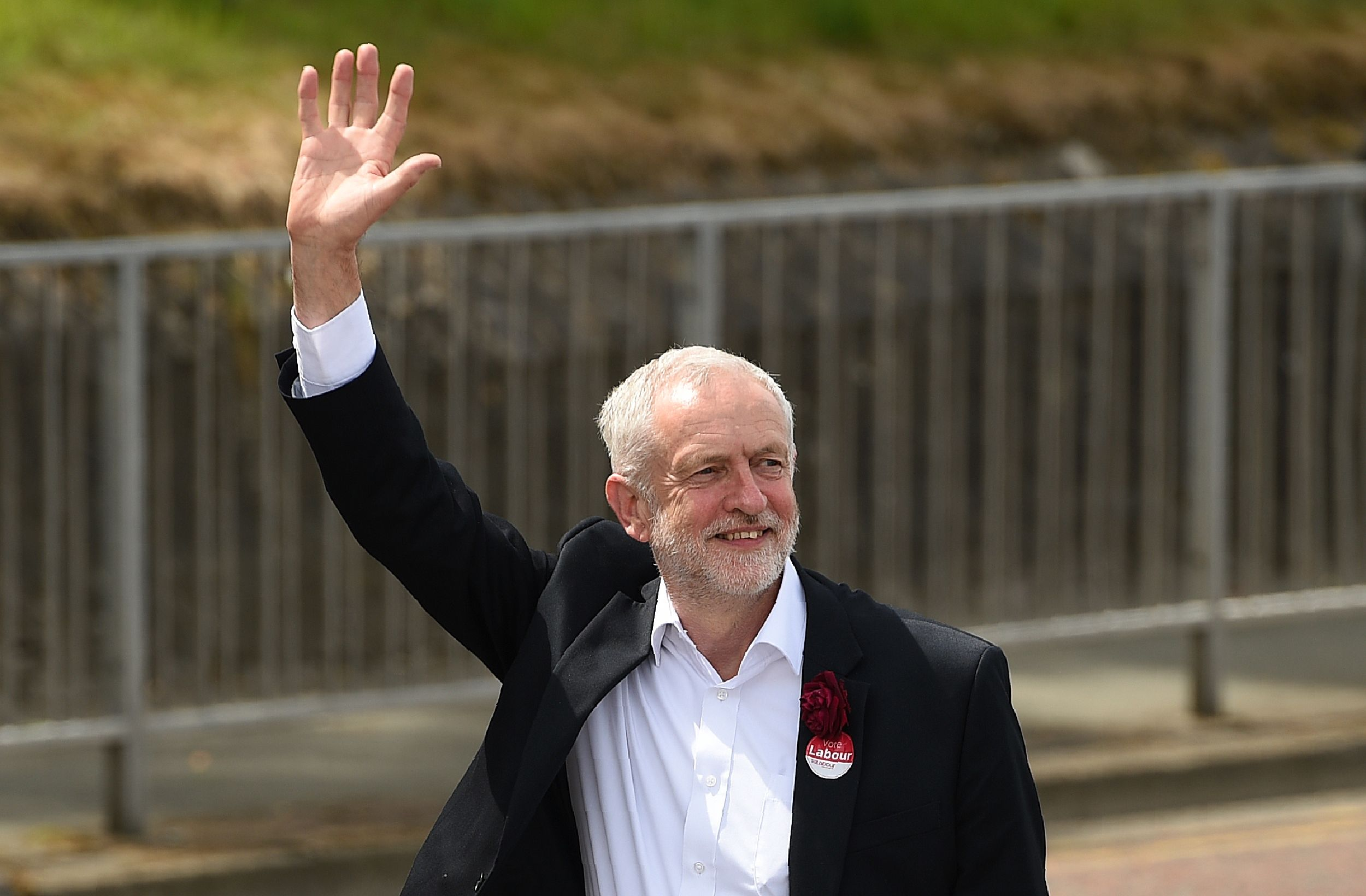 Britain's main opposition Labour Party leader Jeremy Corbyn waves as he arrives to address supporters at a campaign visit in Colwyn Bay, north Wales on June 7, 2017, on the eve of the general election.