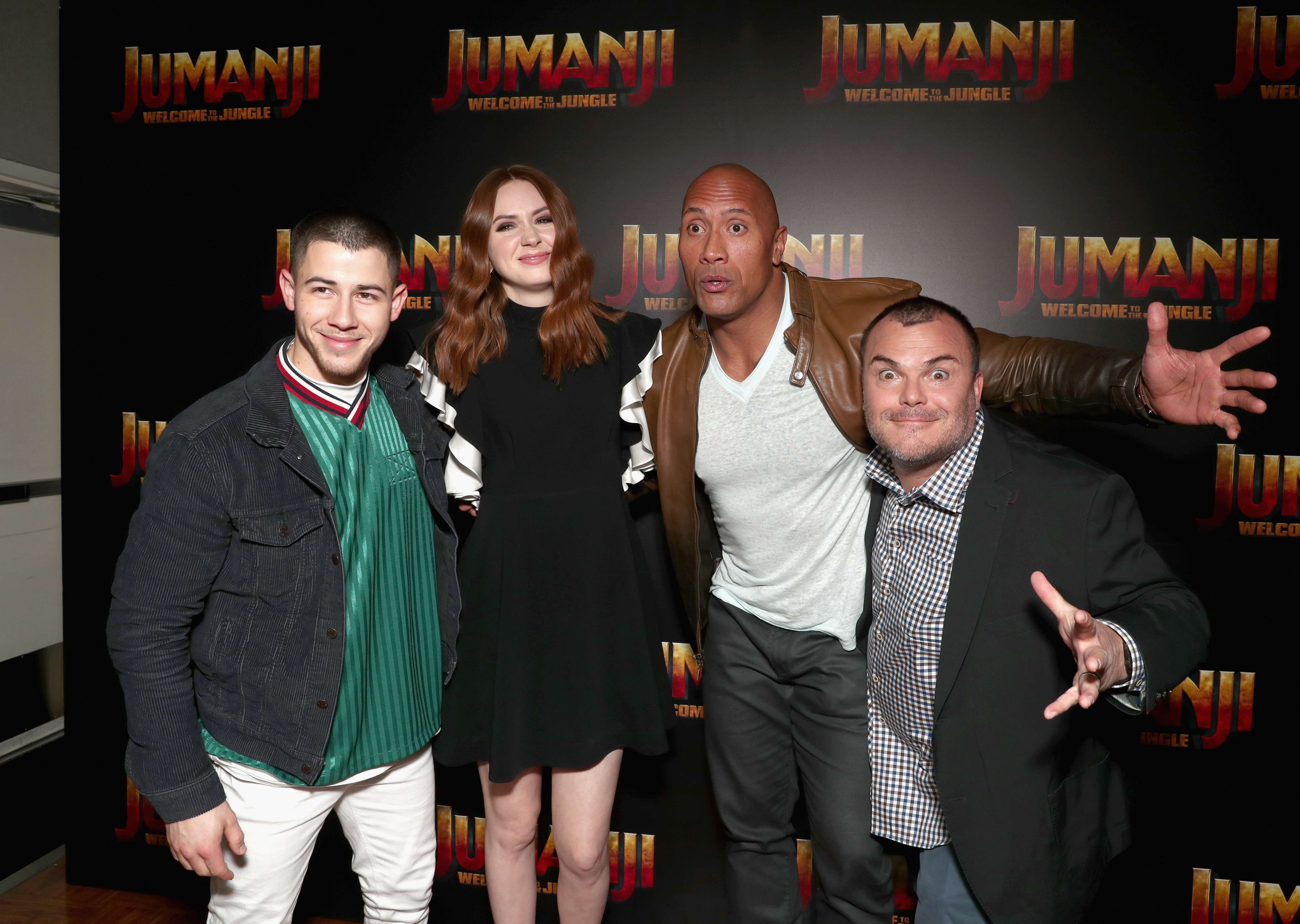 Actors Nick Jonas, Karen Gillan, Dwayne Johnson, and Jack Black during a photo call for Columbia Pictures' JUMANJI: WELCOME TO THE JUNGLE at Caesars Palace during CinemaCon 2017 in Las Vegas, Nevada.