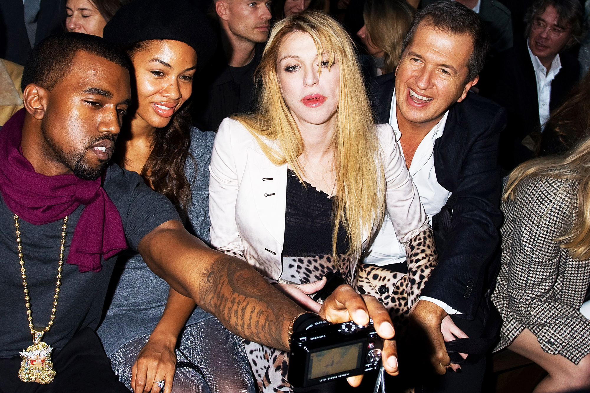 From left: Kanye West, Alexis Pfeiffer, Courtney Love and Mario Testino in Paris, on Oct. 3, 2007.