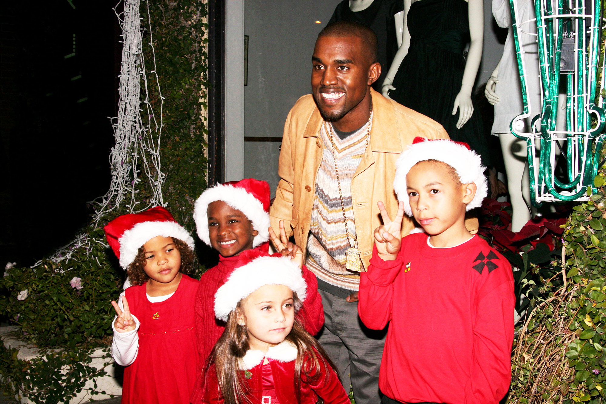 Kanye West poses with children prior to Christmas in Los Angeles, on Dec. 5, 2006.