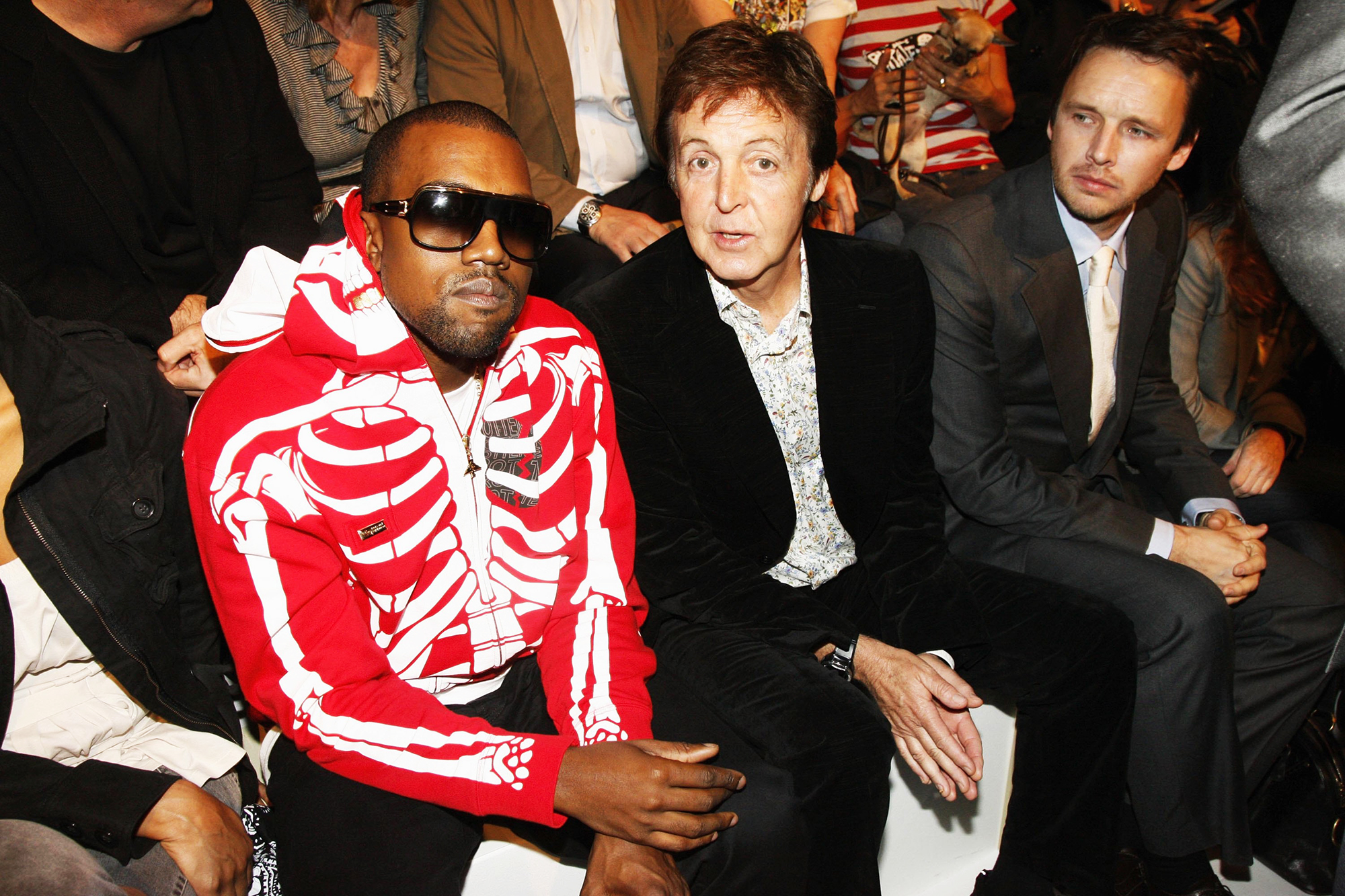 Kanye West and Paul McCartney attend the Stella McCartney Fashion Show, as part of Paris Fashion Week Spring/Summer 2007 in Paris, on Oct. 5, 2006.