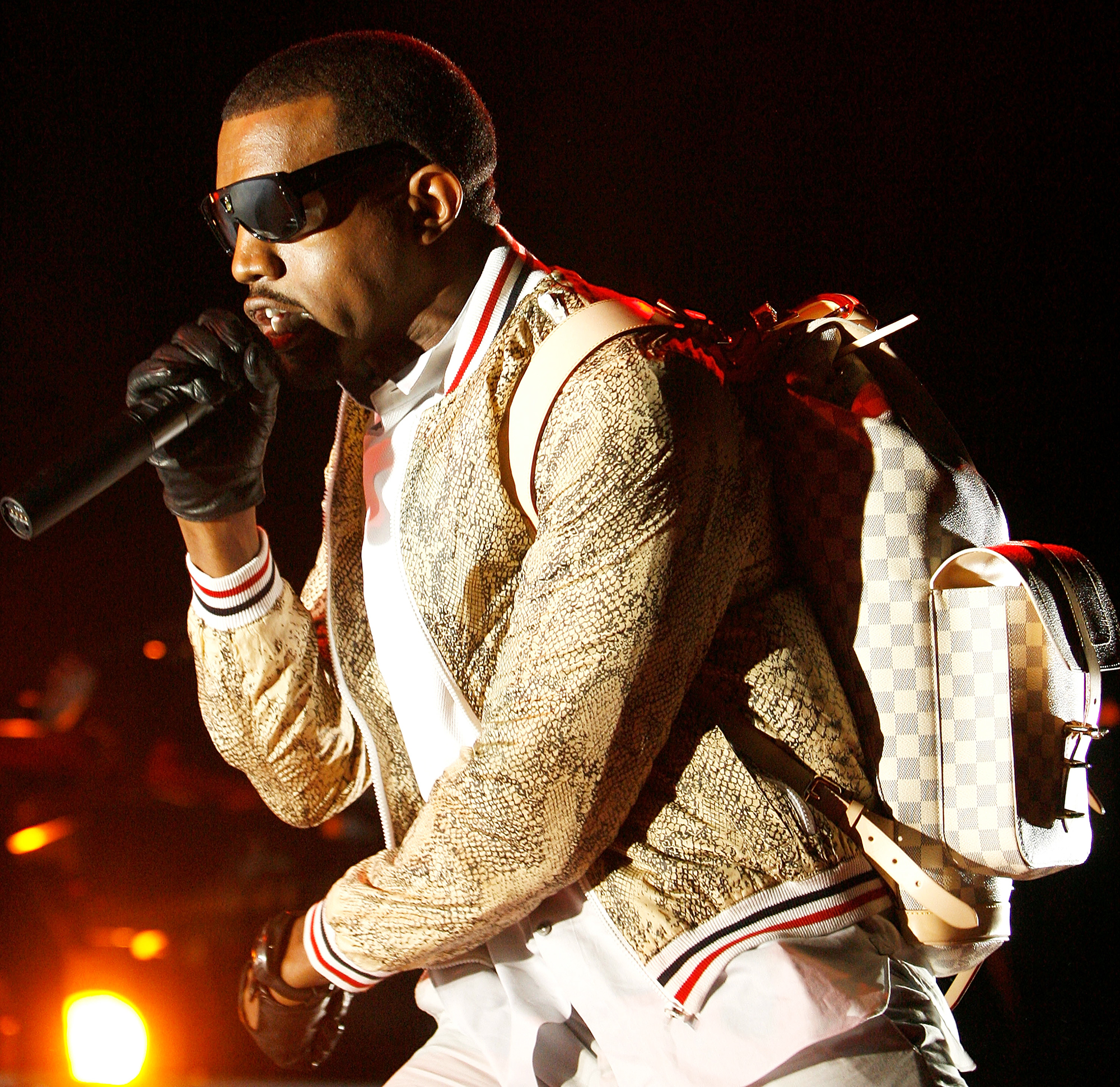 Kanye West wears a custom Louis Vuitton backpack, while performing in New Orleans, on July 4, 2008.