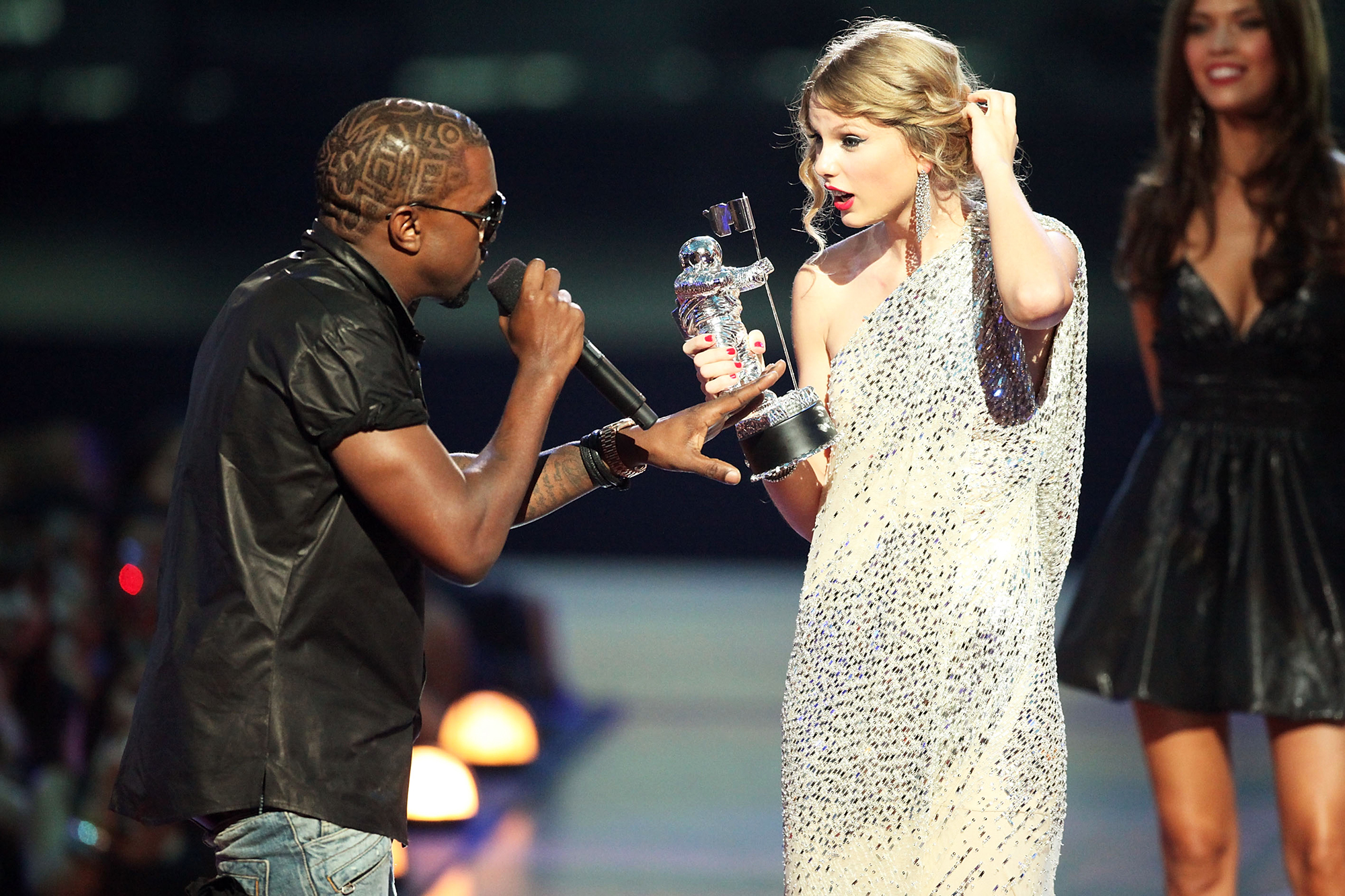 Kanye West jumps onstage after Taylor Swift won the  Best Female Video  award during the 2009 MTV VMAs at Radio City Music Hall in New York City, on Sept. 13, 2009.