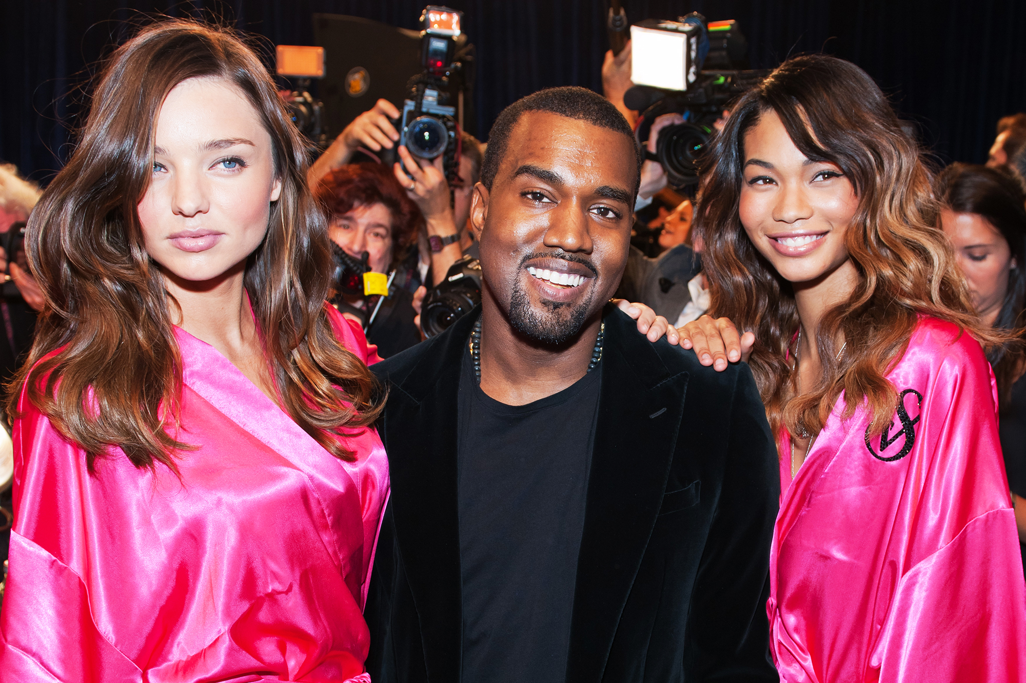 From left: Miranda Kerr, Kanye West and Chanel Iman backstage at the 2011 Victoria's Secret Fashion Show in New York City, on Nov. 9, 2011.