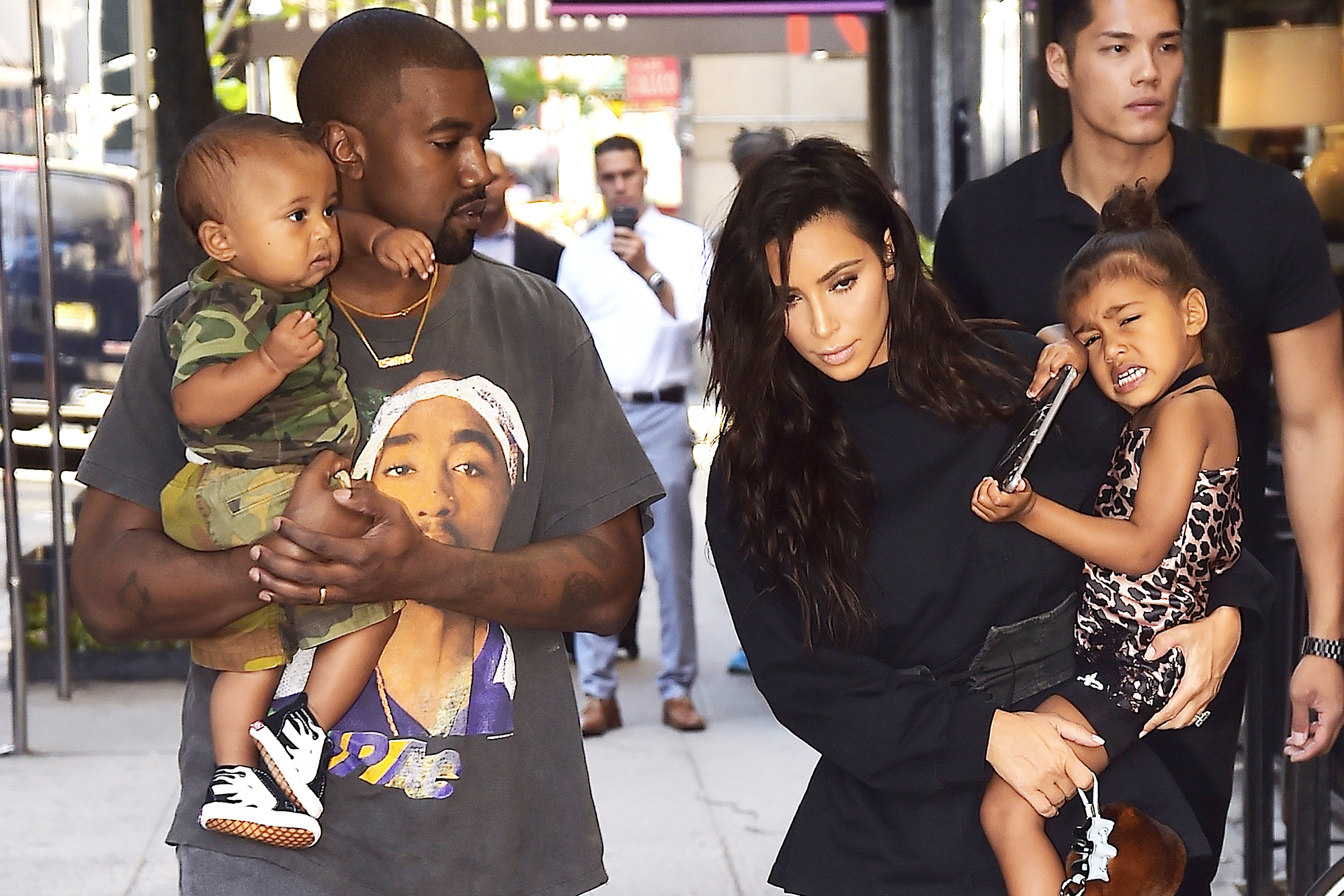 Kanye West and Kim Kardashian, with Saint West, left, and North West, right, in New York City, on Aug. 29, 2016.