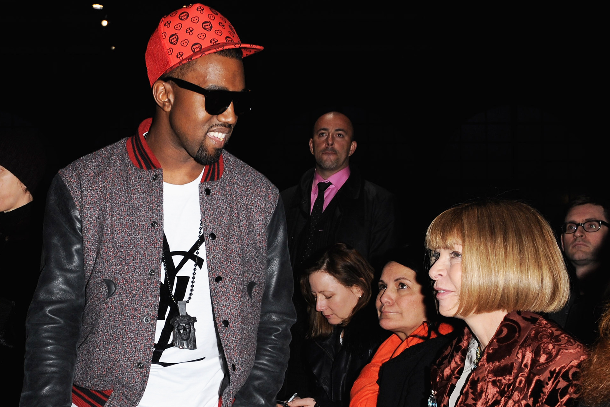 Kanye West speaks with Anna Wintour as they attend the Givenchy Ready-to-Wear A/W 2009 fashion show during Paris Fashion Week in Paris, on March 8, 2009.