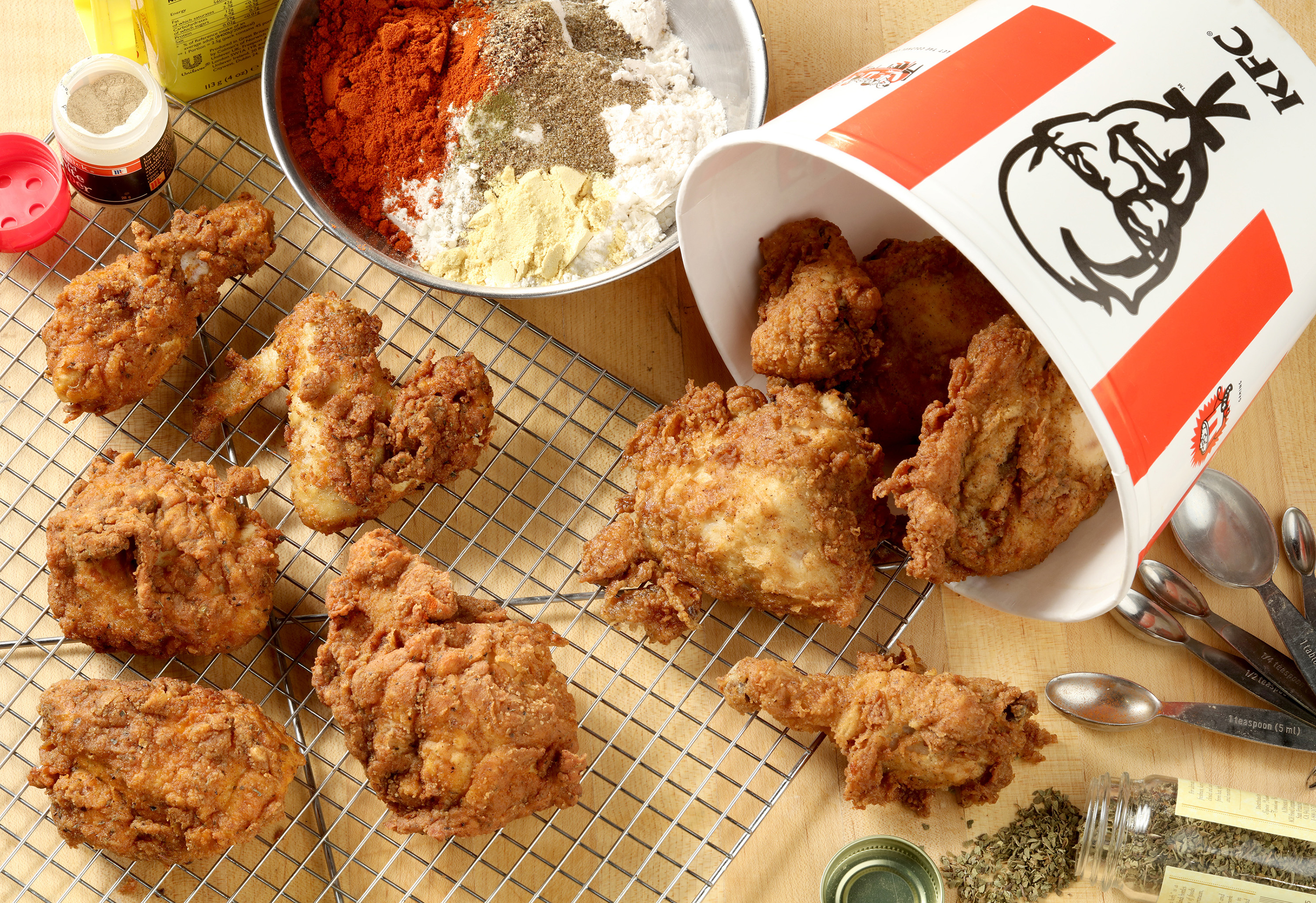 We didn't taste much of a difference between Kentucky Fried Chicken, right, and the fried chicken, left, on wire rack, we made in our test kitchen using a recipe that may - or may not - be Colonel Sanders' secret blend of 11 herbs and spices.