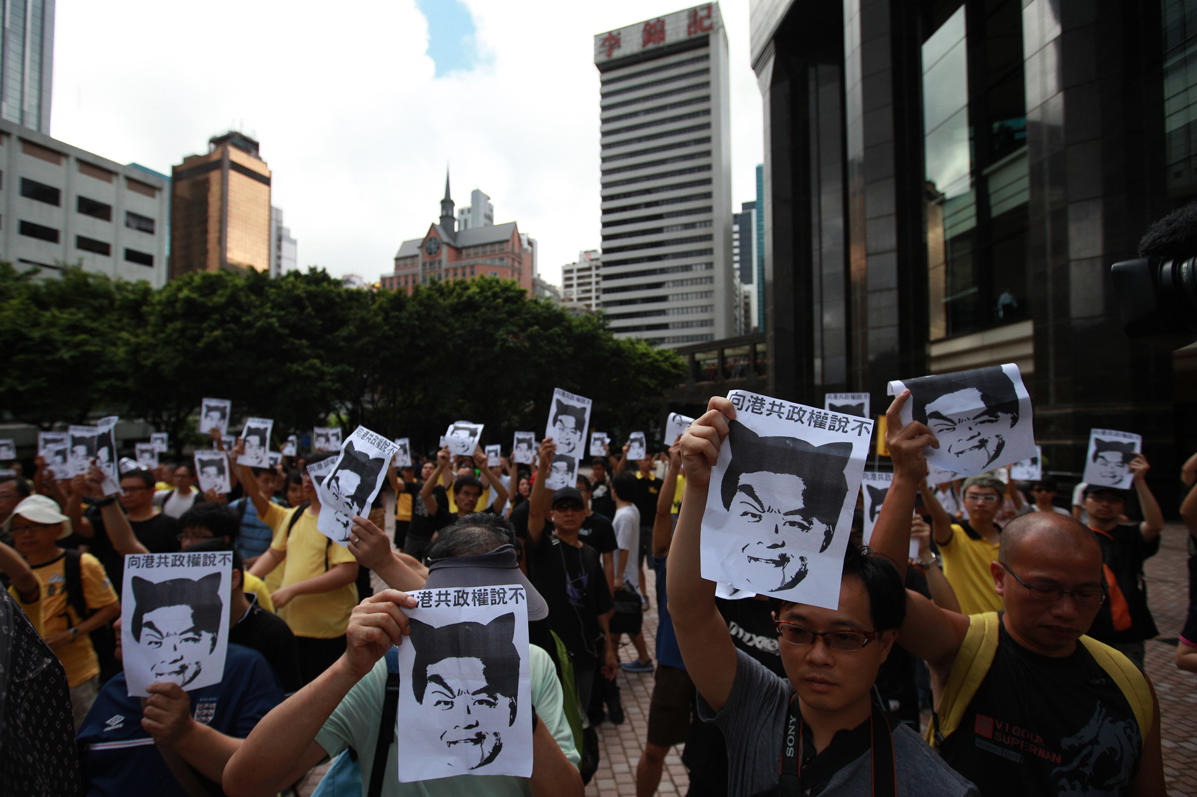 Protesters hold up pictures of Leung Chun-ying during a protest against the deeply unpopular Hong Kong Chief Executive on July 1, 2012. Leung's swearing in coincided with the 15th anniversary of Chinas resumption of sovereignty over Hong Kong. Controversially, he gave his inauguration speech in Mandarin instead of the territory's native Cantonese — one of several signs that caused many Hongkongers to regard him as Beijing's representative and not theirs.