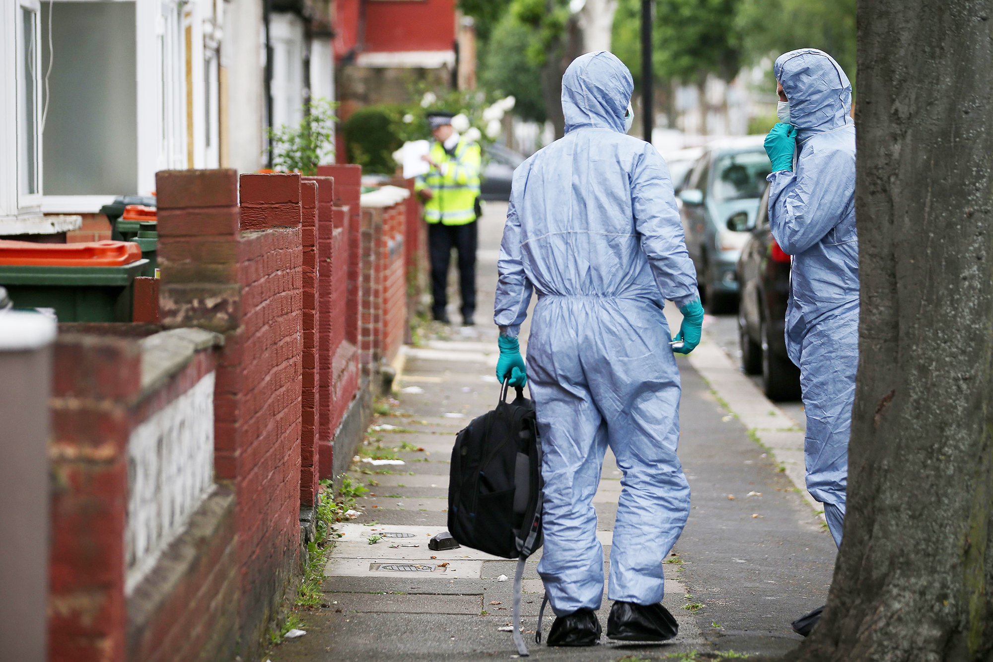 Police forensic officers arrive at a residential property, following a raid, as their investigations continue in east London, on June 5, 2017.
