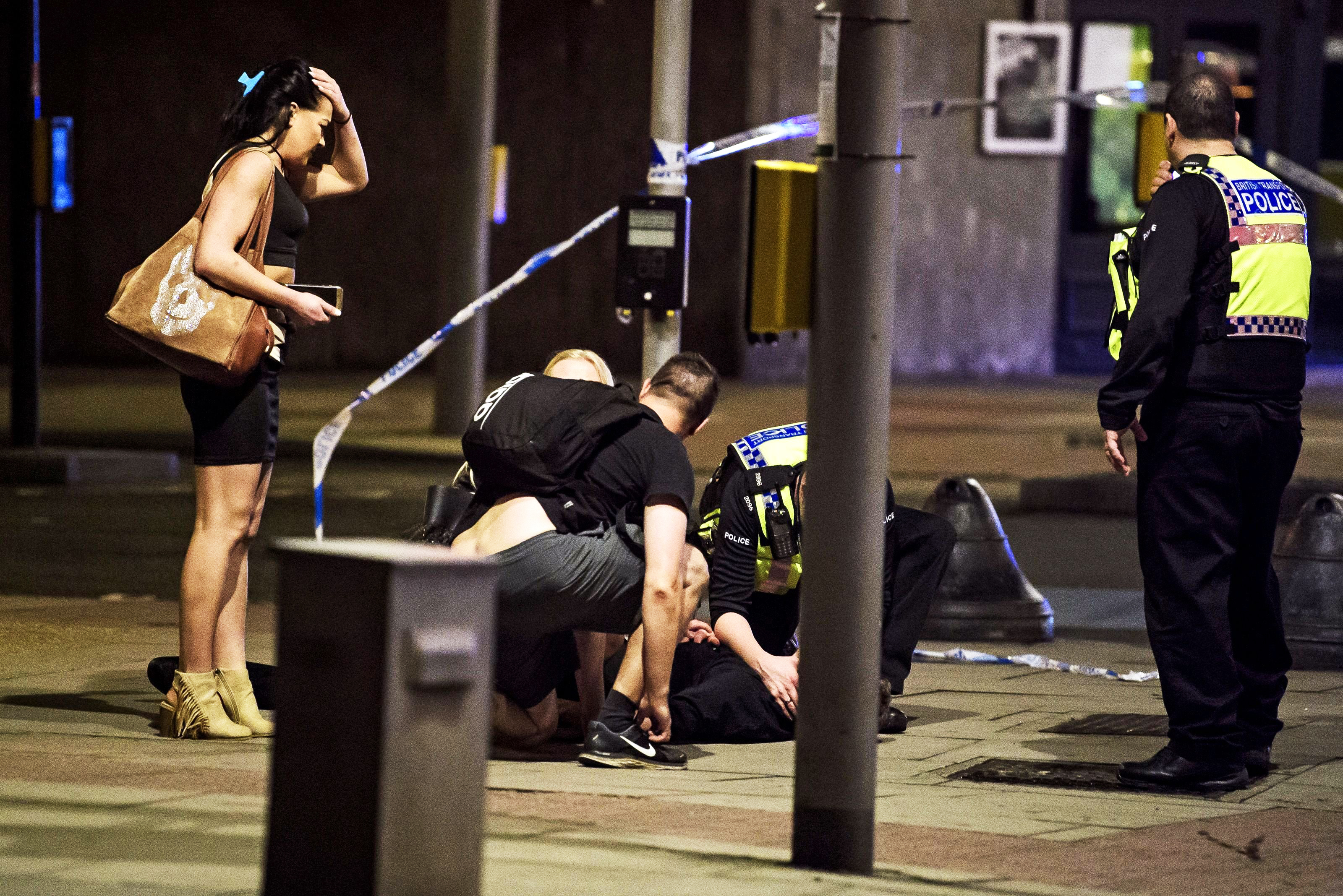 A man being treated near London Bridge after reports of an incident involving a vehicle and pedestrians, on June 3, 2017.