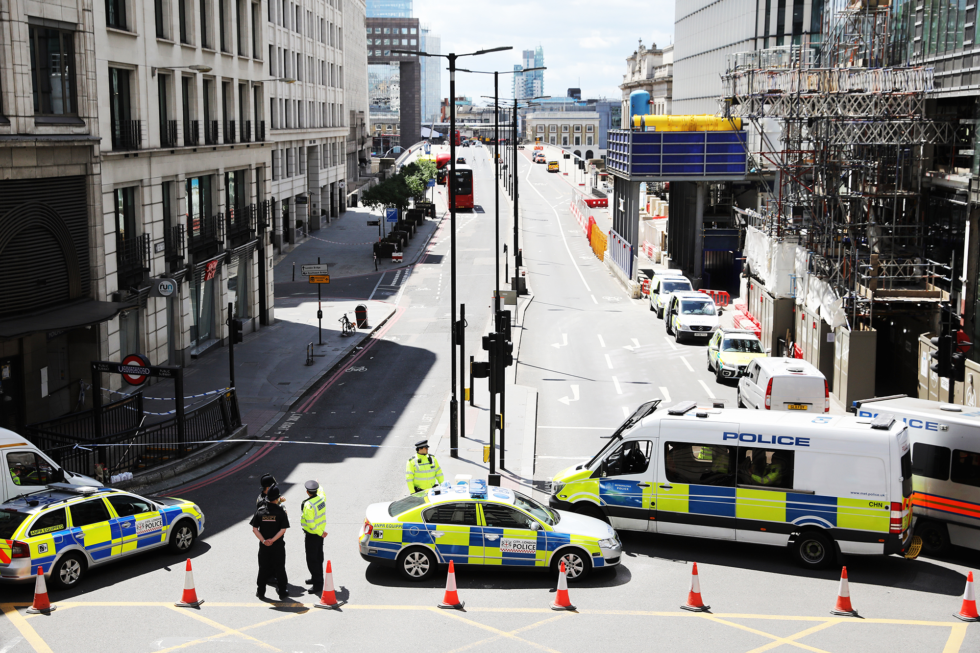 Police operate a cordon on the North side of London Bridge as forensic officers work after Saturday's terrorist attack, on June 4, 2017 in London.