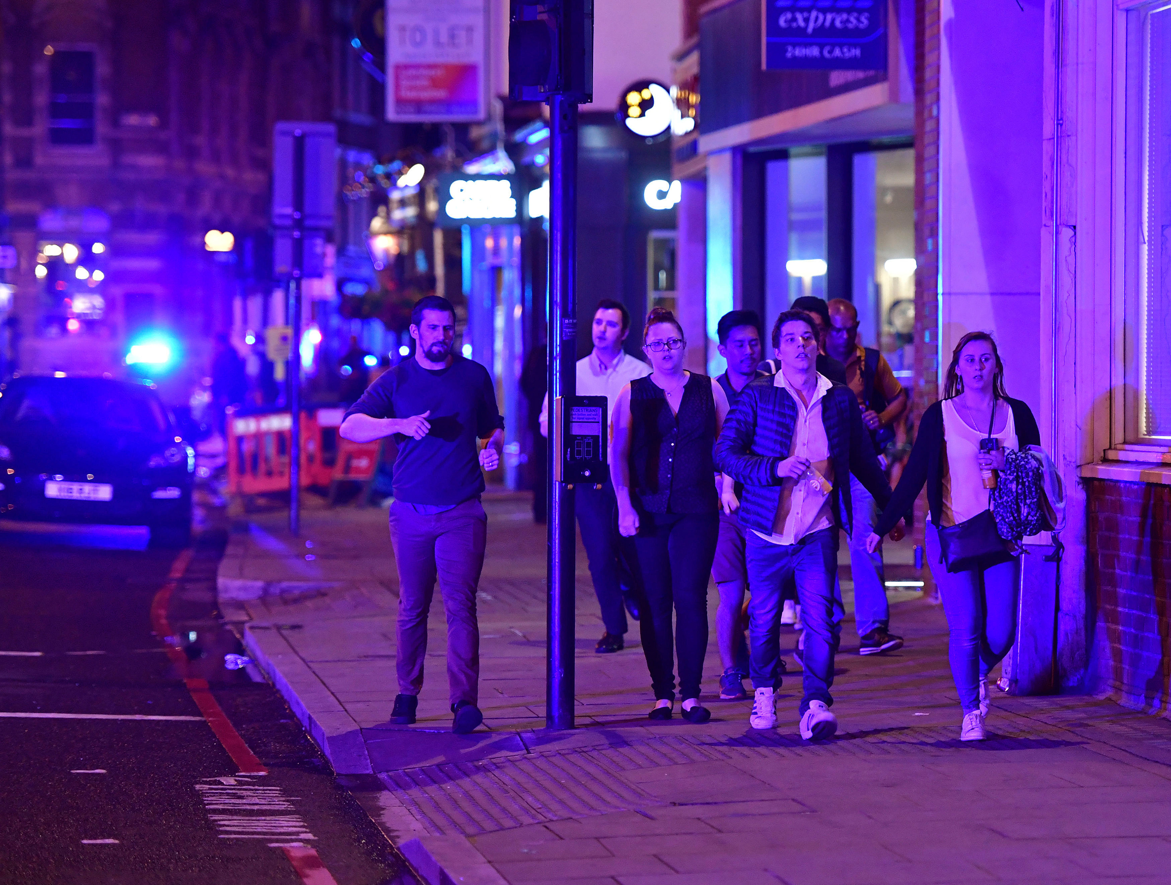 People run down Borough High Street as police are dealing with a  major incident  at London Bridge on June 3, 2017.